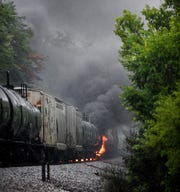 "Smoke rises from a CSX train following the derailment of a tank car carrying a ""highly flammable and toxic"" gas Thursday, July 2, 2015, in Maryville, Tenn. The single tank car loaded with acrylonitrile, a hazardous material used in a variety of industrial processes including the manufacture of plastics, forced an evacuation of residences and businesses in a two-mile radius."