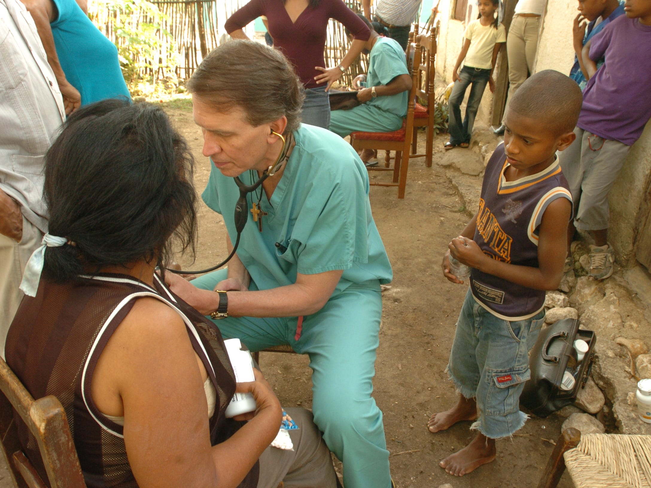 During one of their many house call sessions Dr. Clint Doiron checks the blood pressure of a villager. 2/4/2005