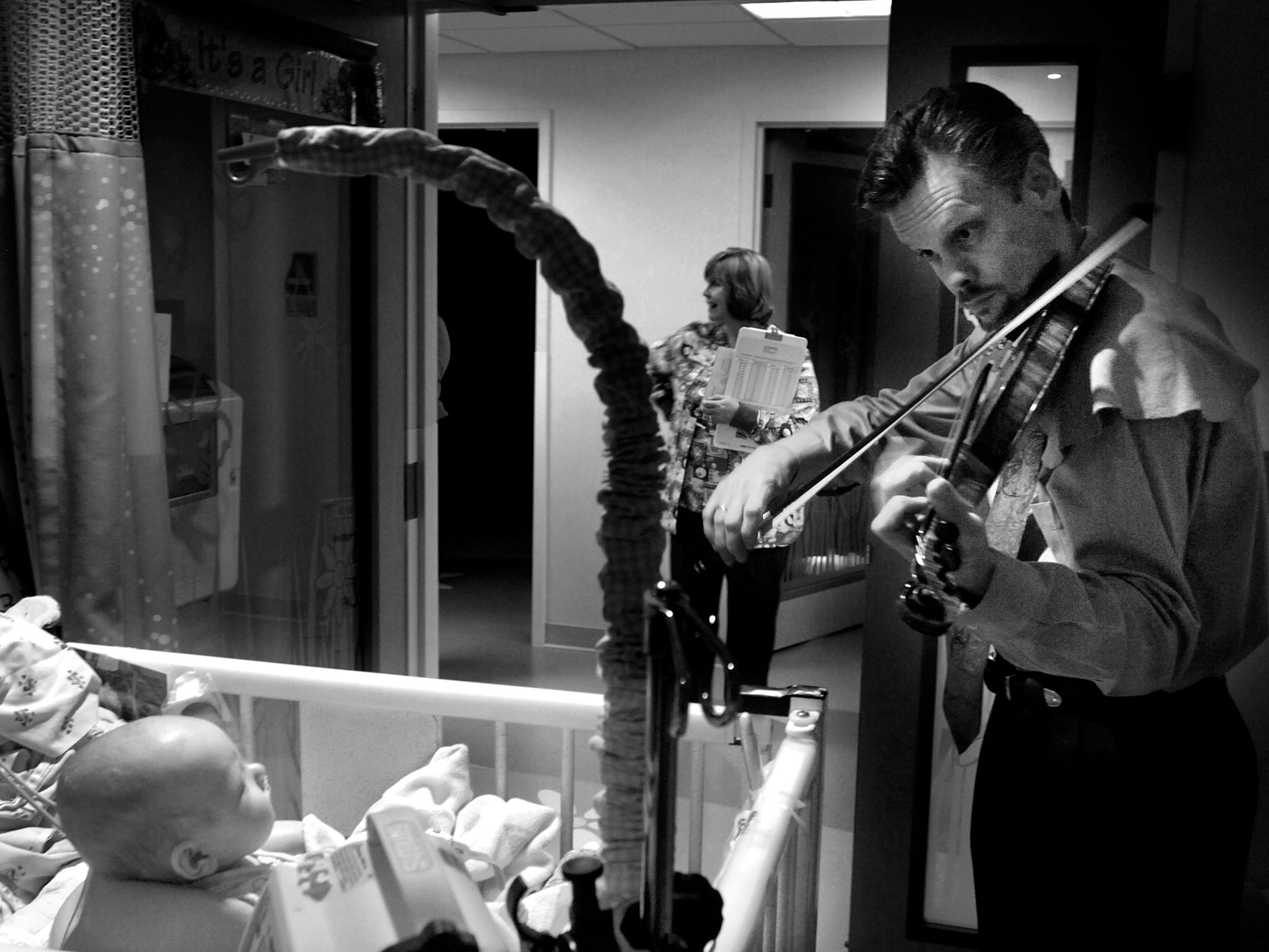 Nurses told violinist Sean Claire that this young patient had never turned her head to the right before. Claire walked through the halls of the Neonatal Intensive Care Unit of the UT Medical Center playing his music for the patients, staff and parents.