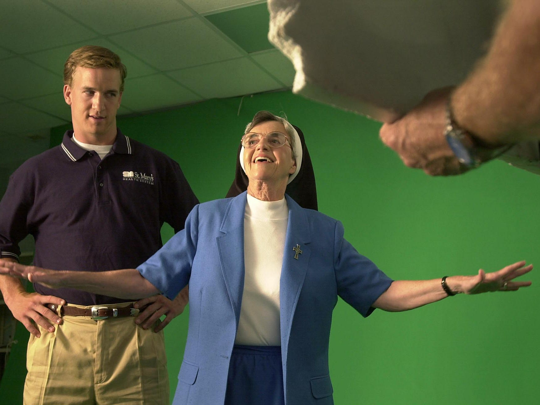 Sister Maris Stella films a commercial for St. Mary's Health System with Peyton Manning on Nov. 13, 1999.