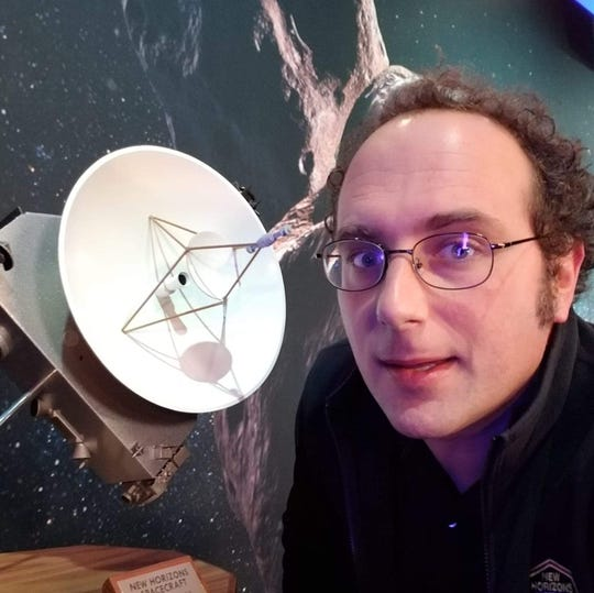 Ted Stryk, Roane State Community College associate professor, next to model New Horizons spacecraft.