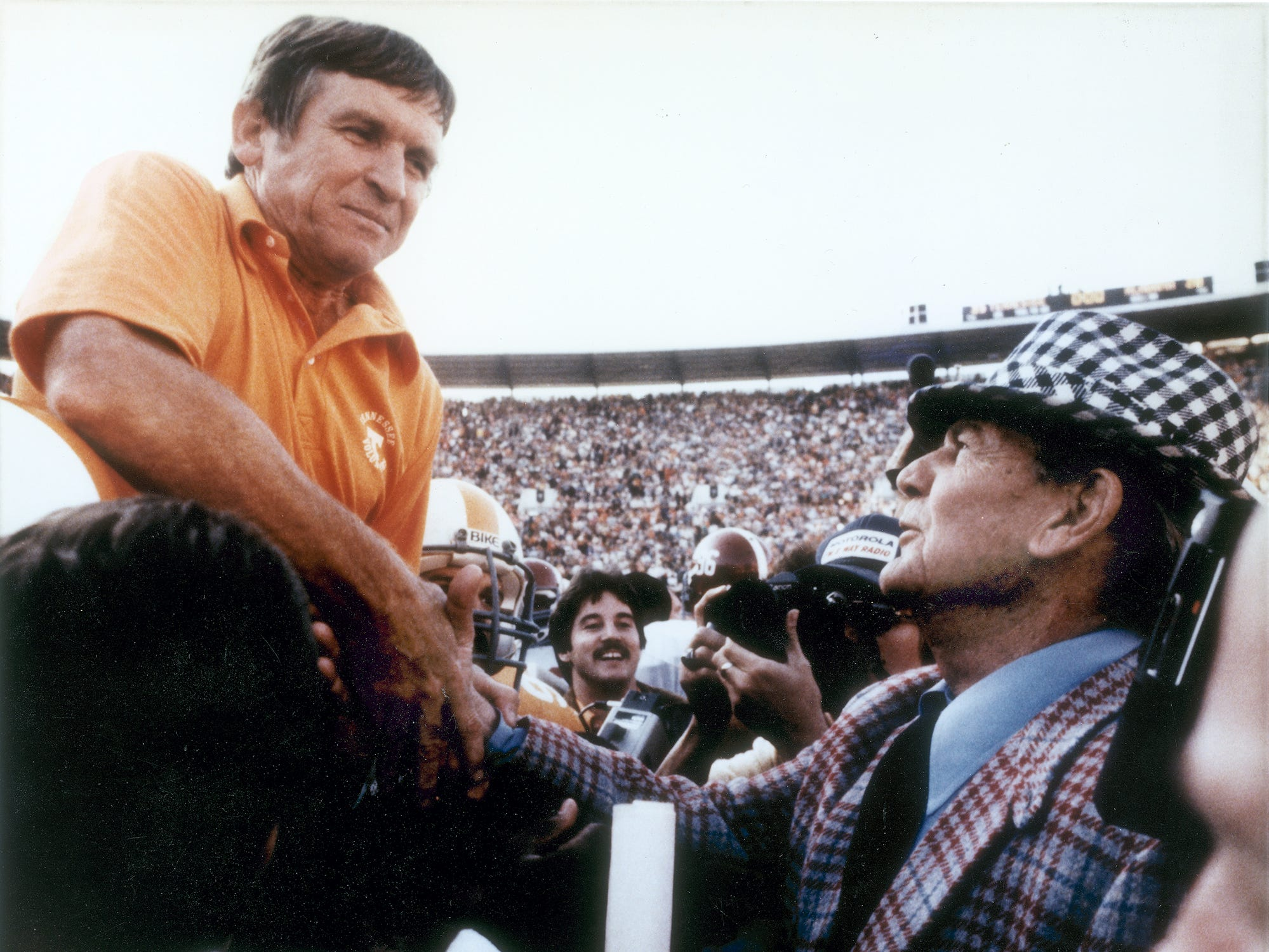 The 1982 Volunteers carry Tennessee Head Coach Johnny Majors on their shoulders to meet Alabama Head Coach Bear Bryant mid-field after their victory in Neyland Stadium.