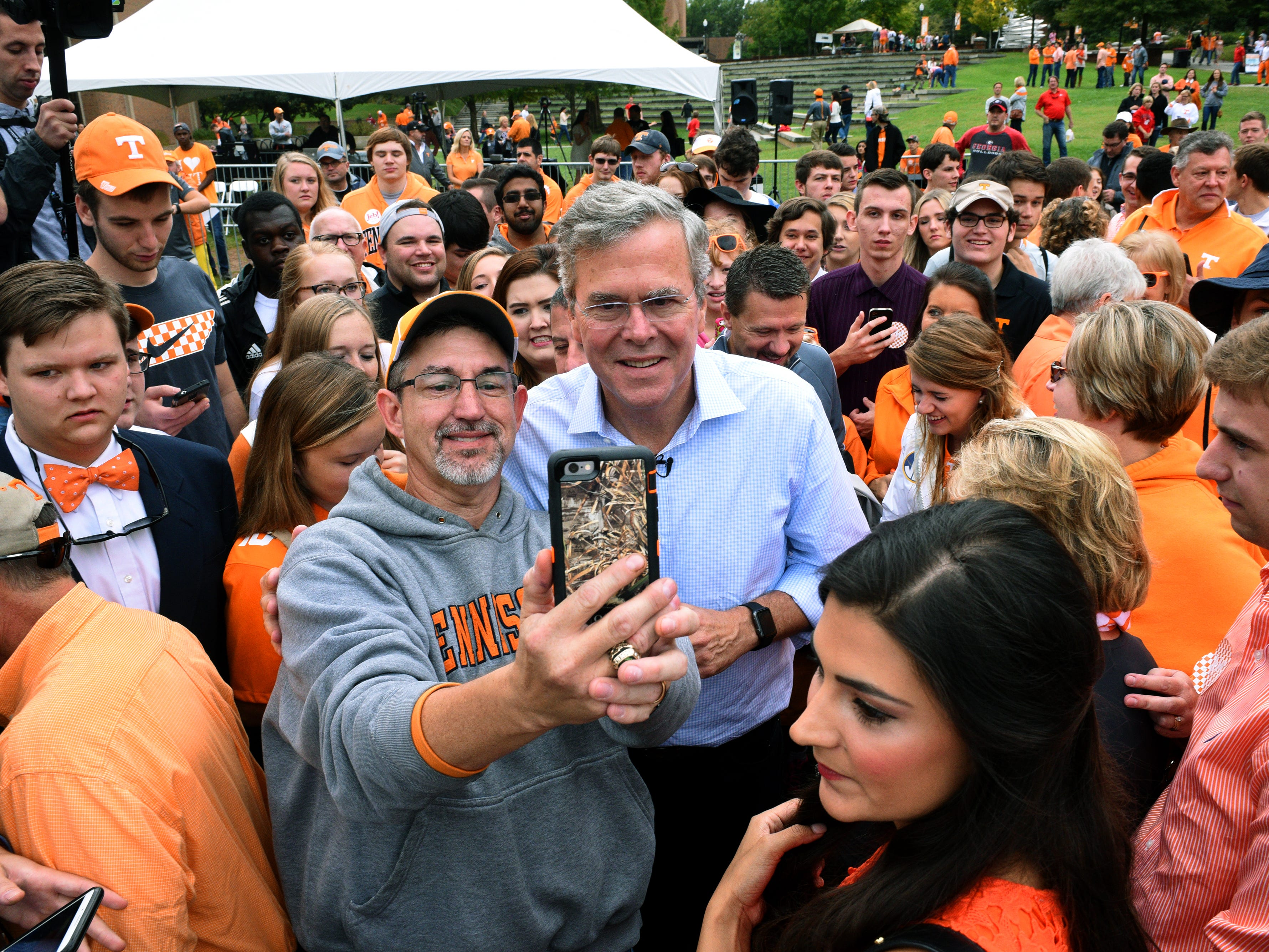 Jeb Bush posed after every request for a selfie while visiting the University of Tennessee campus before the Tennessee vs. Georgia game Saturday, Oct. 10, 2015.