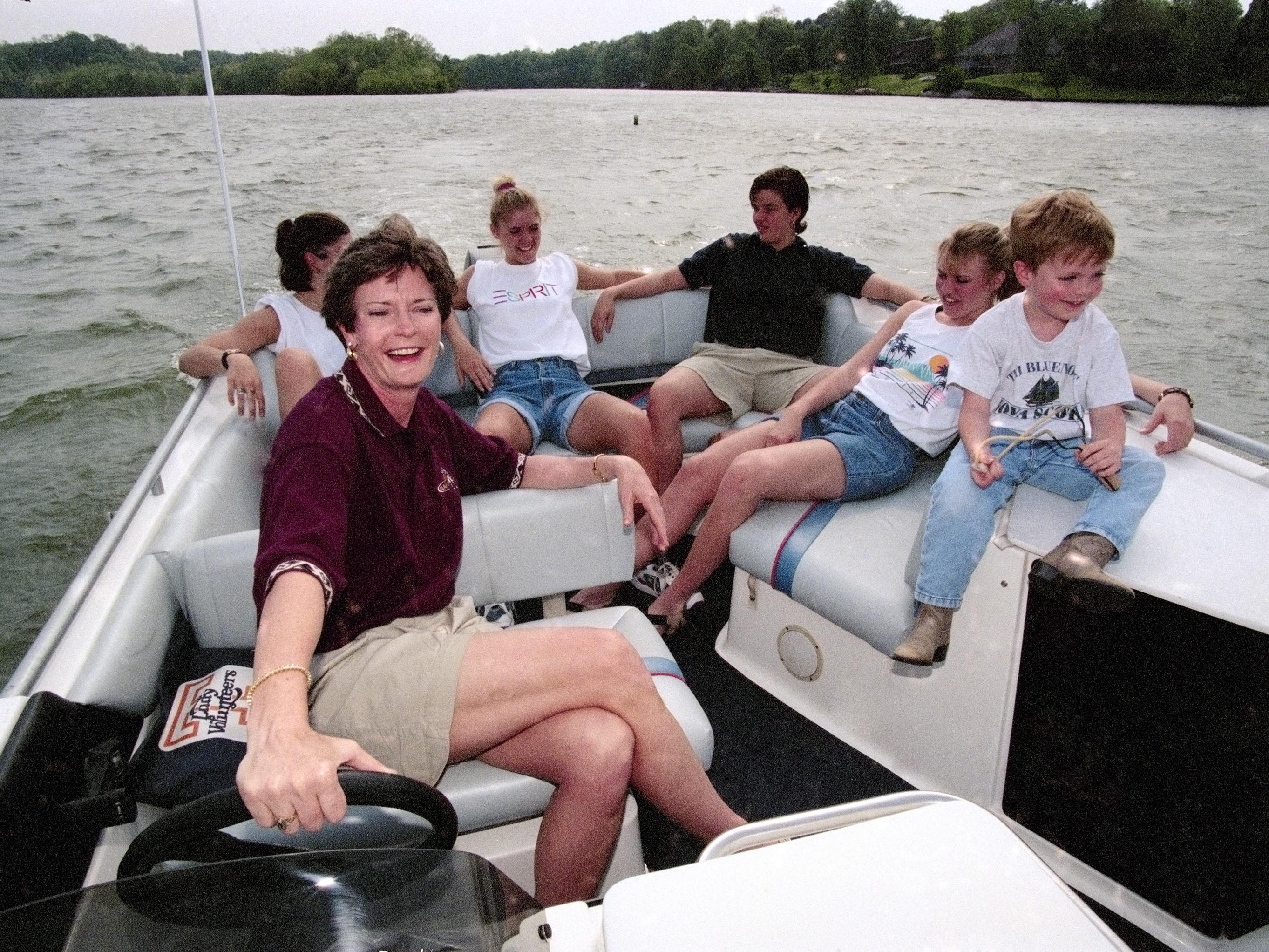 Coach Pat Summitt and her son, Tyler, take some Lady Vol team members for a boat ride on May 26, 1996 on Fort Loudoun Lake near Knoxville.