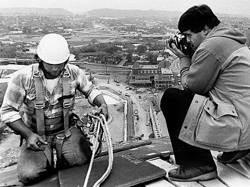 Michael Patrick takes a photo of Donnie Cusick, from Seymour, while he is working on installing sheets of sheet metal 260 feet above ground on the top of the Sunsphere on October 23, 1981.