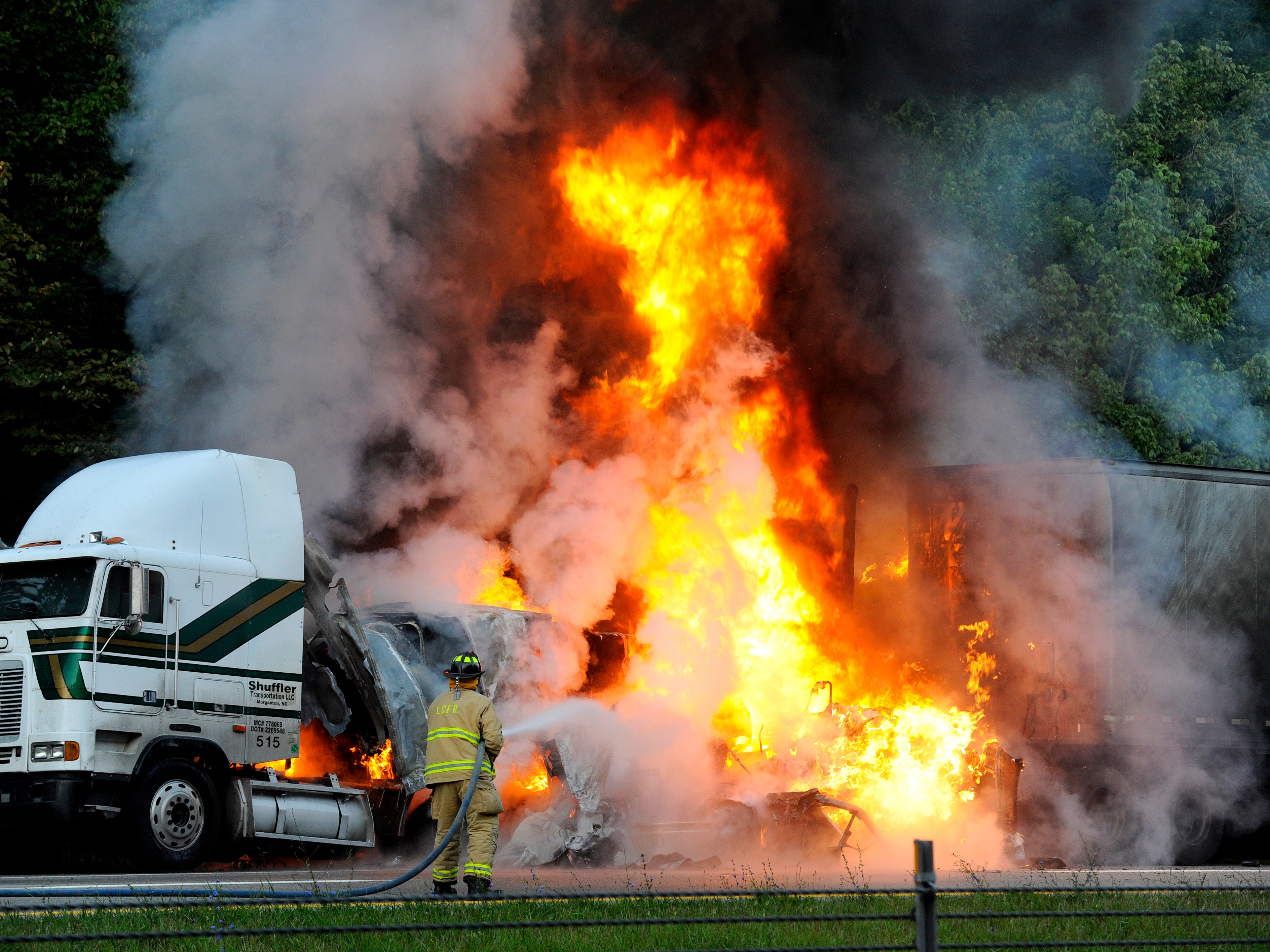 Fiery crash on I-40 eastbound just east of the US321 Lenoir City exit halted traffic Tuesday, July 29, 2014. Two tractor-trailers in this photo and third vehicle (located about 500 yards west) collided and all three caught fire. Authorities are still investigating at the scene.