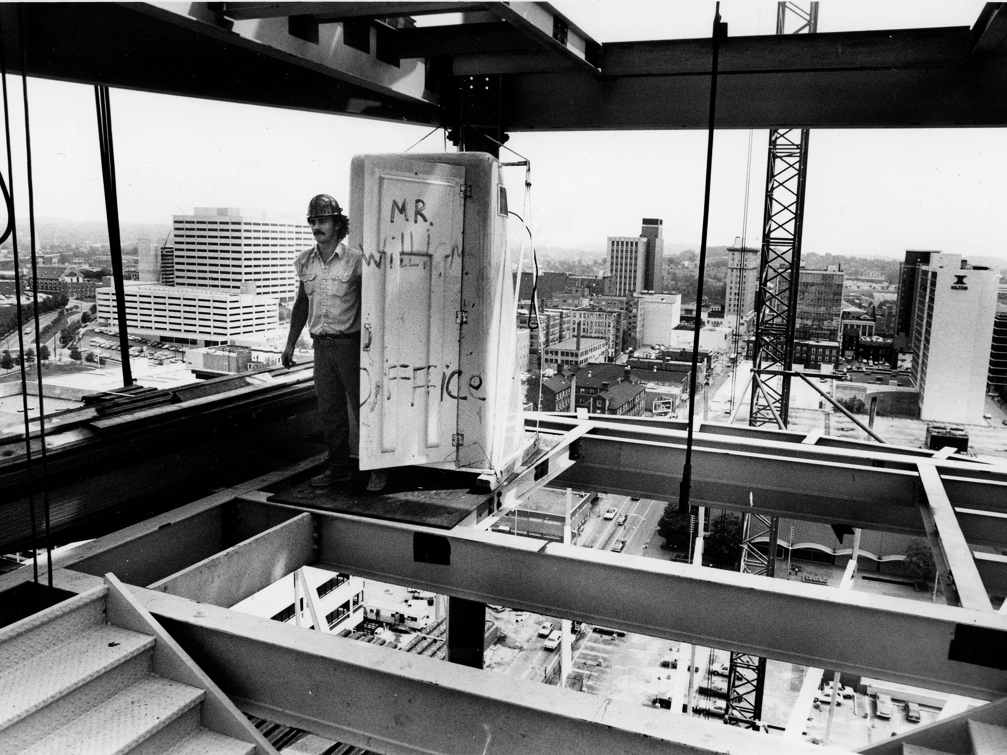 Buddy Beets, of Knoxville, comes out of a portable john 255 feet above ground on September 13, 1981.