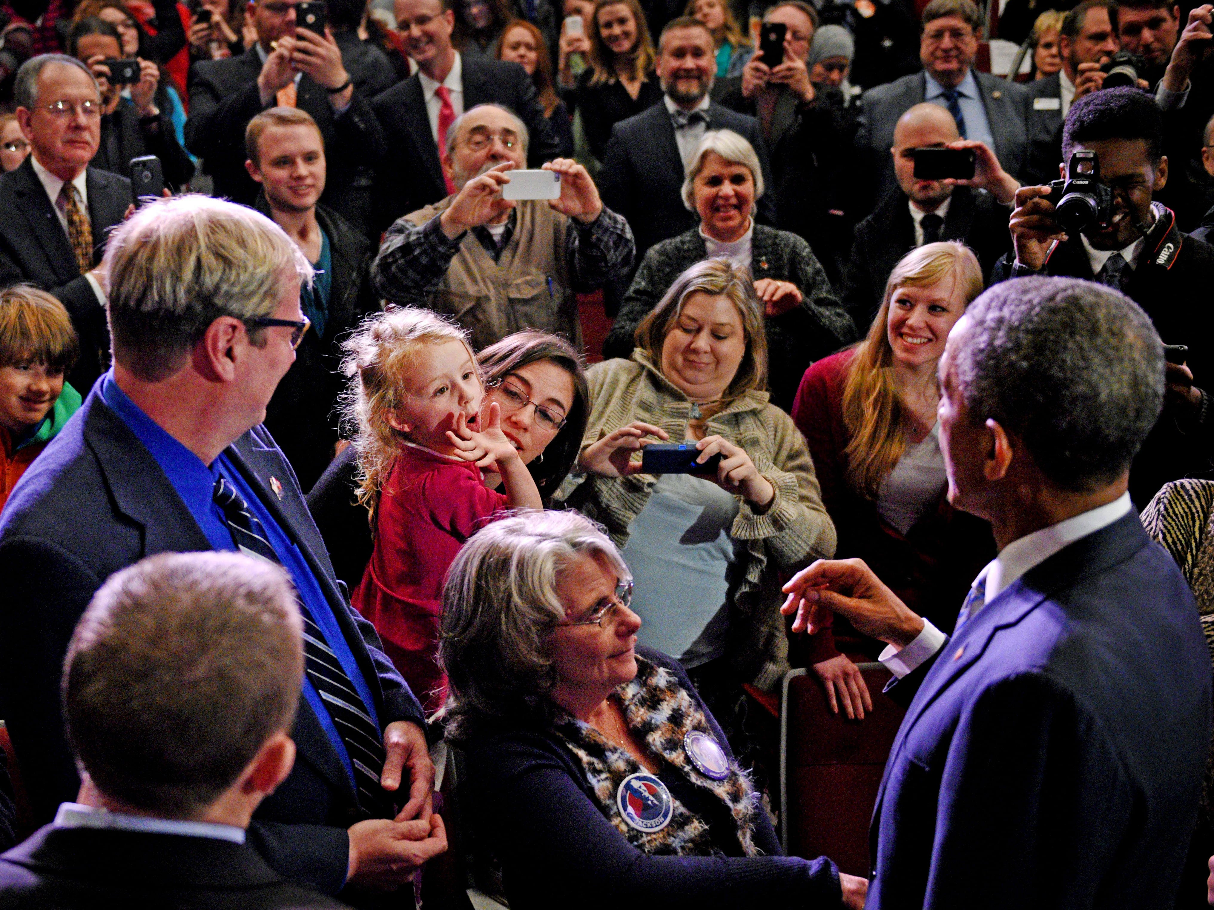Kathryn Durr gets the attention of President Barack Obama after he finished speaking at Pellissippi State Community College Friday, Jan. 9, 2015.