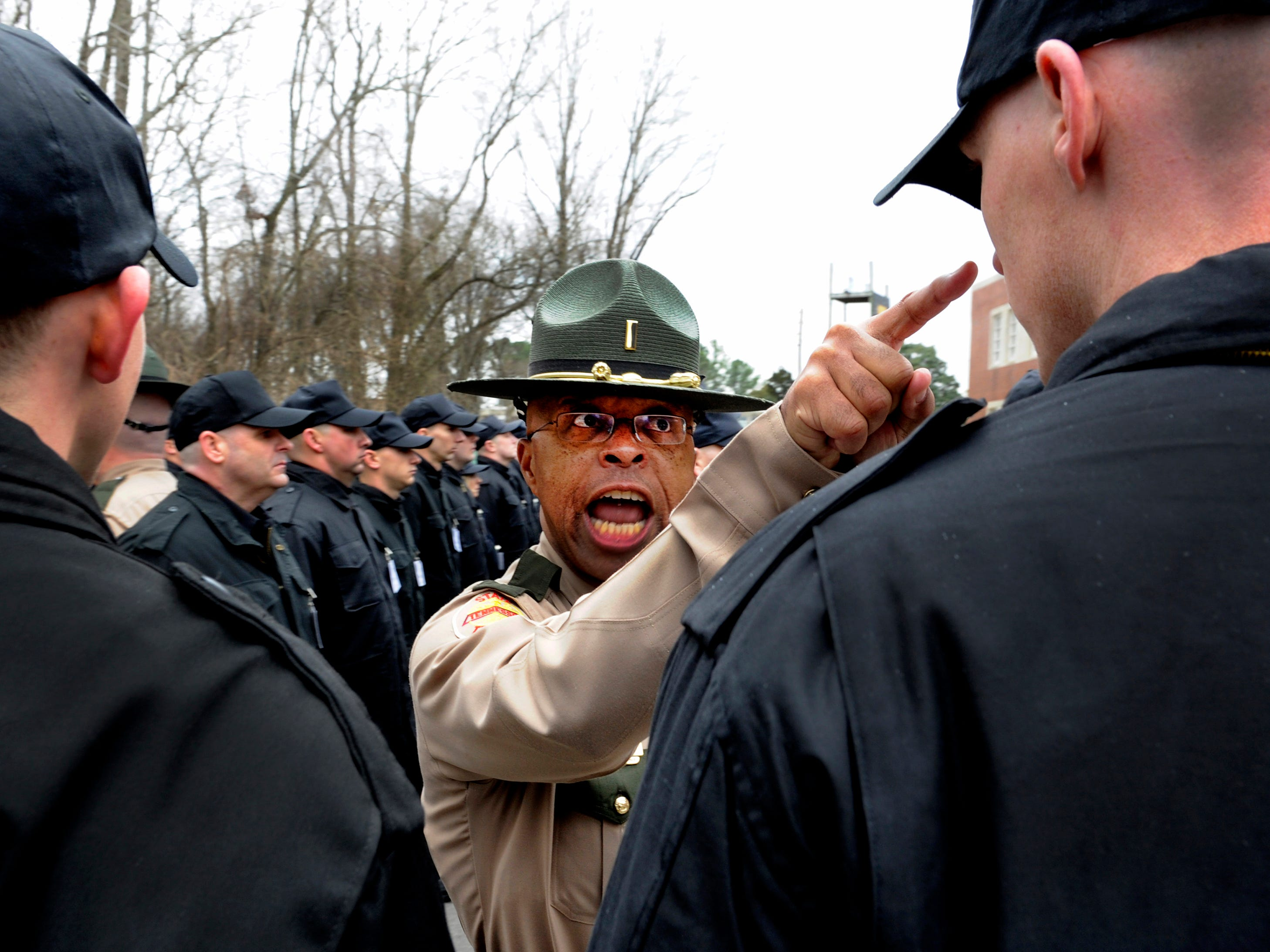 """Tennessee Highway Patrol cadet Brian Ramsey said, """"I've always looked up to Troopers,"""" but by the end of the first snow and sleet filled March day at the Tennessee Highway Patrol Training Center in Donaldson he was thinking to himself, """"I can't believe I'm going to have to do this for 18 more weeks."""" Early on Ramsey caught the attention of Lt. Robert Bighem, assistant director of the academy, who singled out Ramsey during one of the first outdoor formations. Bighem says, """"We're in their face because we want them to be able to work under pressure."""" He added, """"Citizens of the state depend on the highway patrol so if they can handle the controlled stress here they can handle the stress out there."""""""