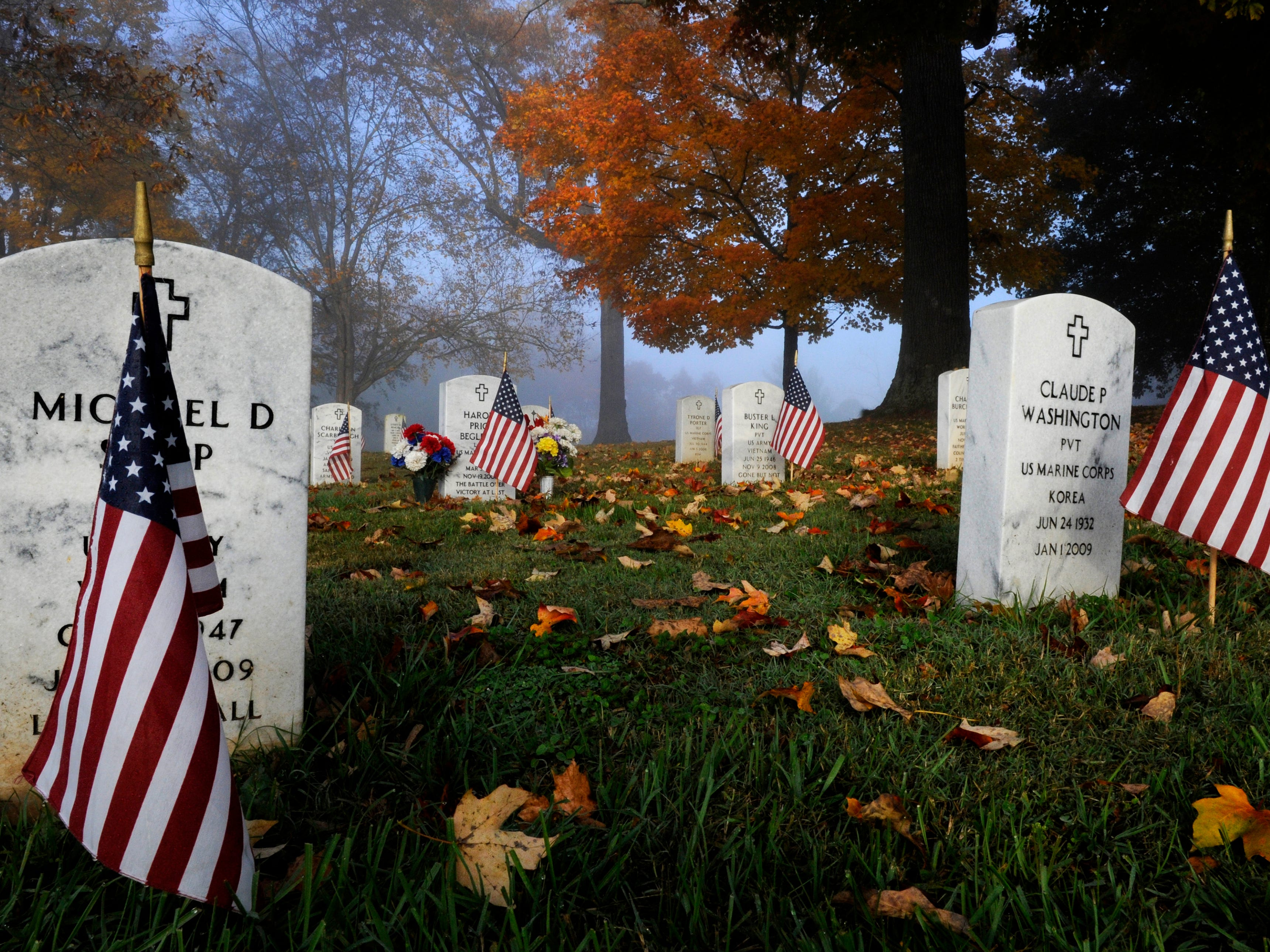 Morning fog lays over the East Tennessee State Veterans Cemetery on Lyons View Pike on Veteran's Day Tuesday, Nov. 11, 2014.