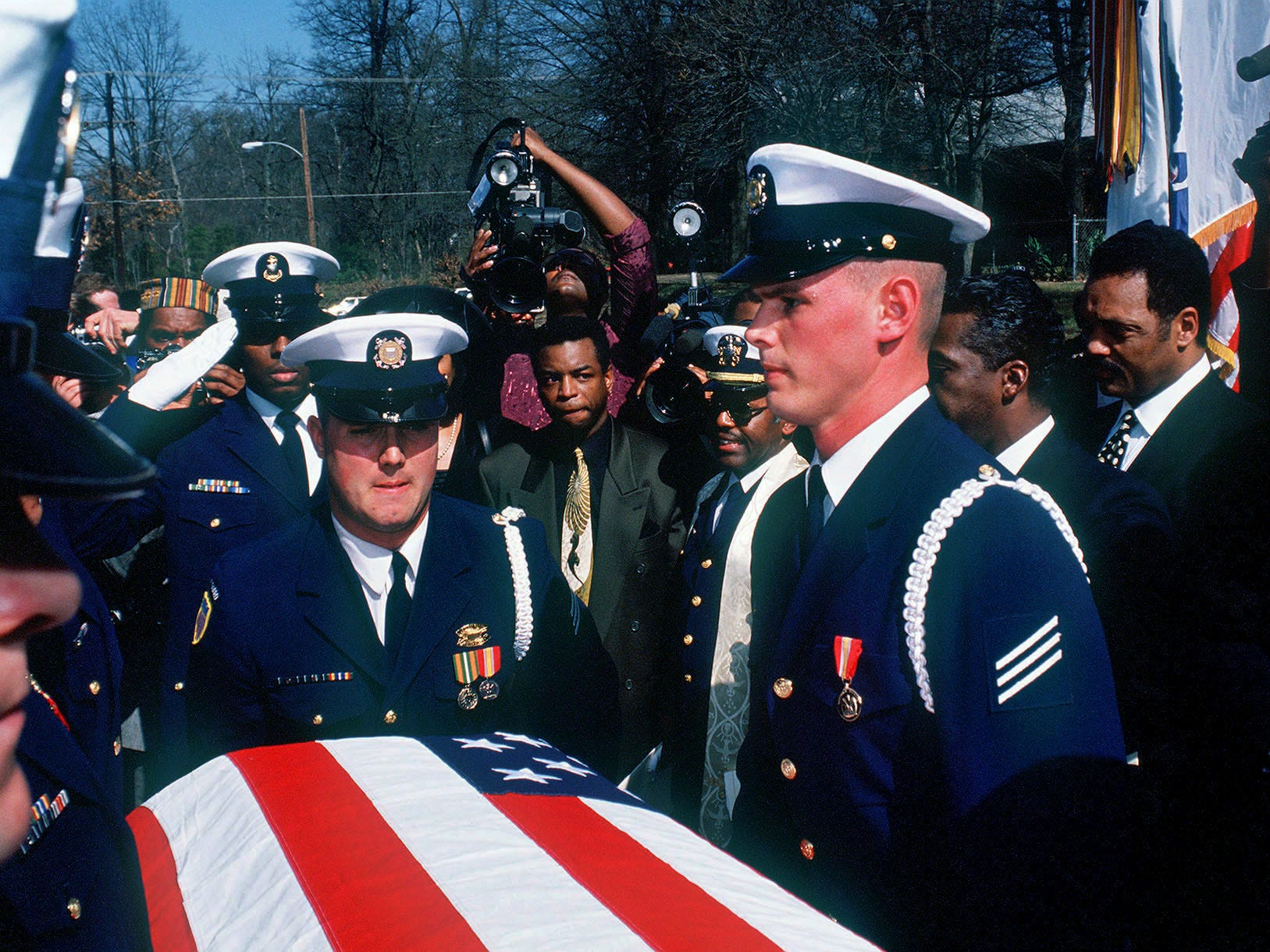 """A U.S. Coast Guard honor guard bears the casket of Alex Haley after funeral services Saturday in Memphis. """"Roots"""" star LaVar Burton, center with gold tie, and the Rev. Jesse Jackson, far right, accompany the casket Feb. 15, 1992."""