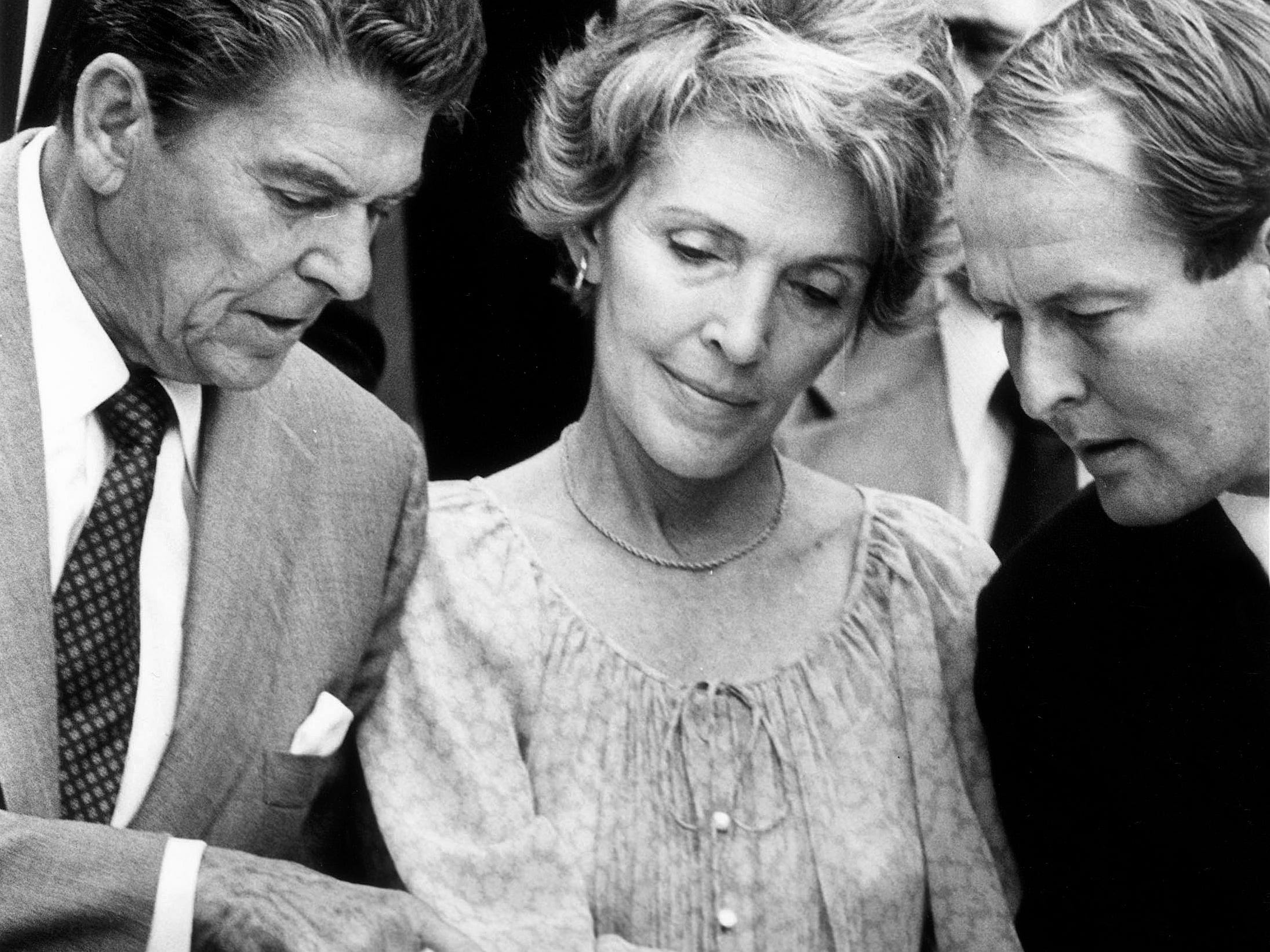 Ronald Reagan, Nancy Reagan, and Gov. Lamar Alexander confer during Reagan's campaign appearance Sept. 21, 1980, in Knoxville.