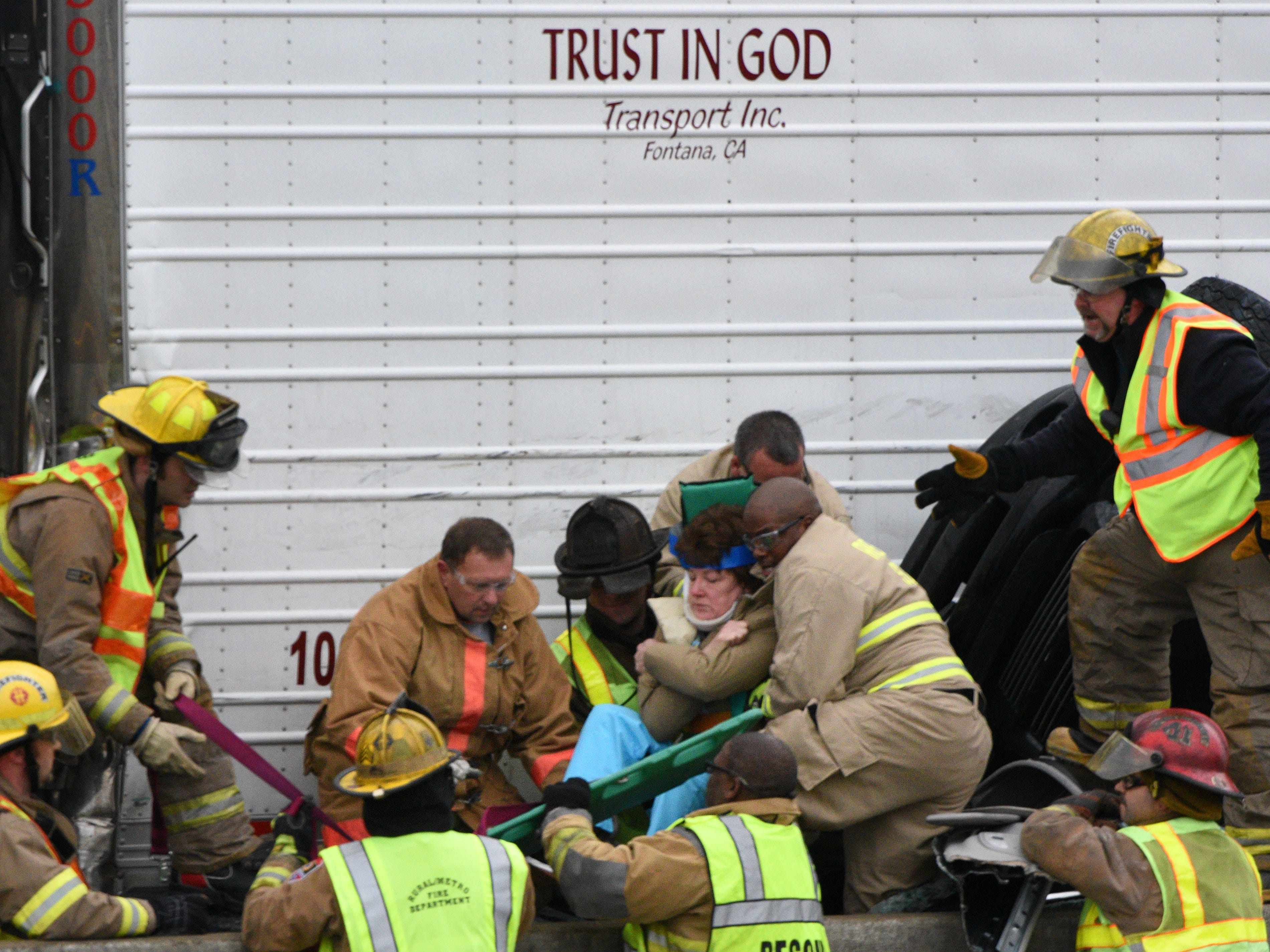 Members of the Knoxville Volunteer Emergency Rescue Squad work Thursday to extract a female patient from a vehicle crushed against a concrete barrier wall by a tractor-trailer rig on Interstate 40 East near the Watt Road interchange Thursday, Dec. 4, 2014.