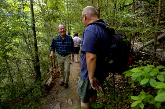 Sen. Lamar Alexander encounters other park visitors while hiking in the Great Smoky Mountains National Park on a trail near the Tremont Institute on Friday, May 25, 2007.