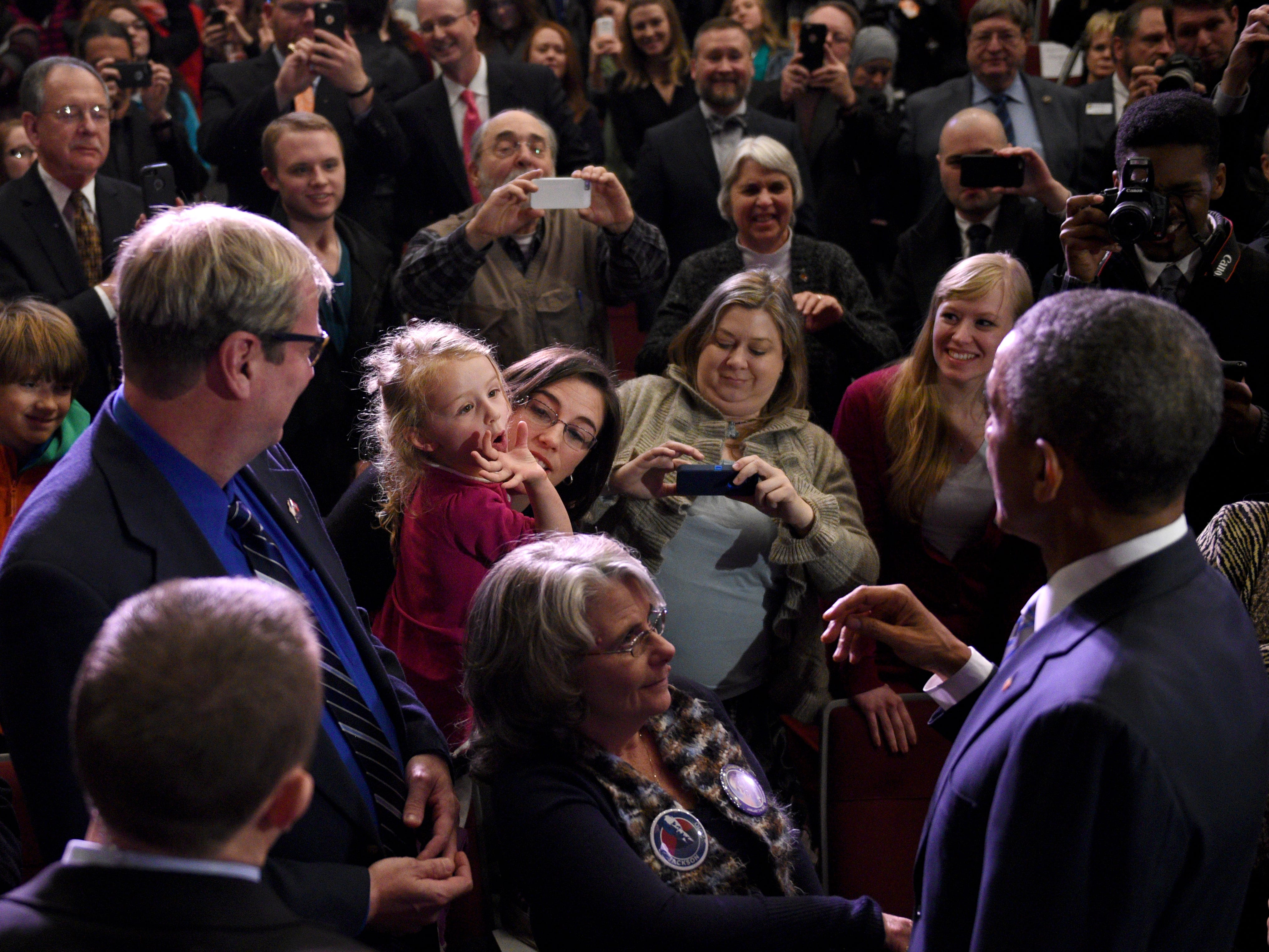 Covering a Presidential visit is fun, hectic, and challenging as you try and capture some photo others don't see. Young Kathryn Durr gave me that photo as she yells at President Obama to get his attention after he finished speaking at Pellissippi State Community College in Knoxville Friday, Jan. 9, 2015.