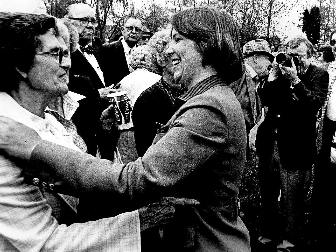 U.S. Sen. Howard H. Baker Jr. photographs his daughter, Cissy Baker, as she declares her candidacy for the Republican nomination for the 4th Congressional District seat on May 8, 1982, in Huntsville, Tenn.