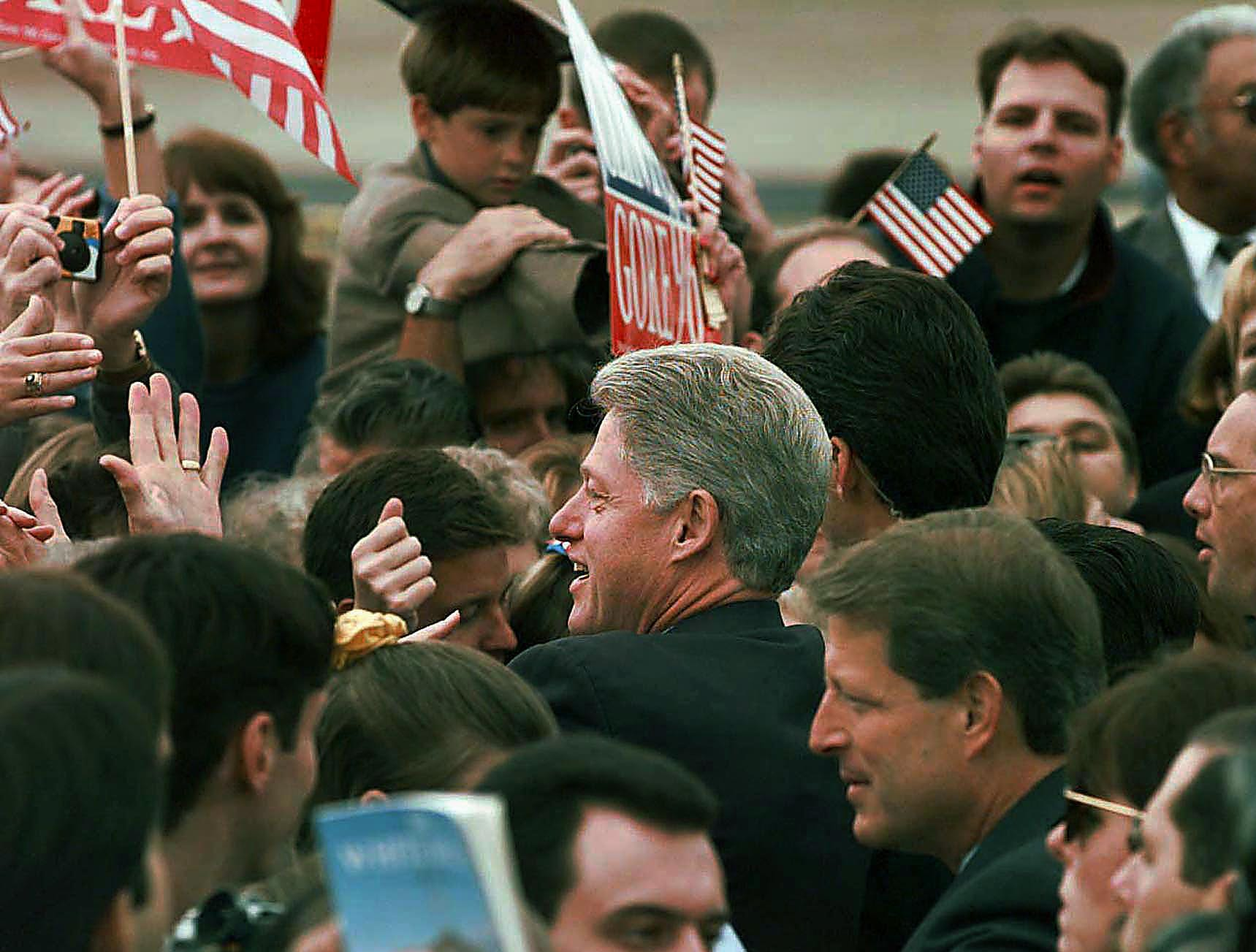 President Bill Clinton and Vice-president Al Gore shake hands with supporters at KnoxAir after they both arrived in separate planes Thursday morning. 1996.