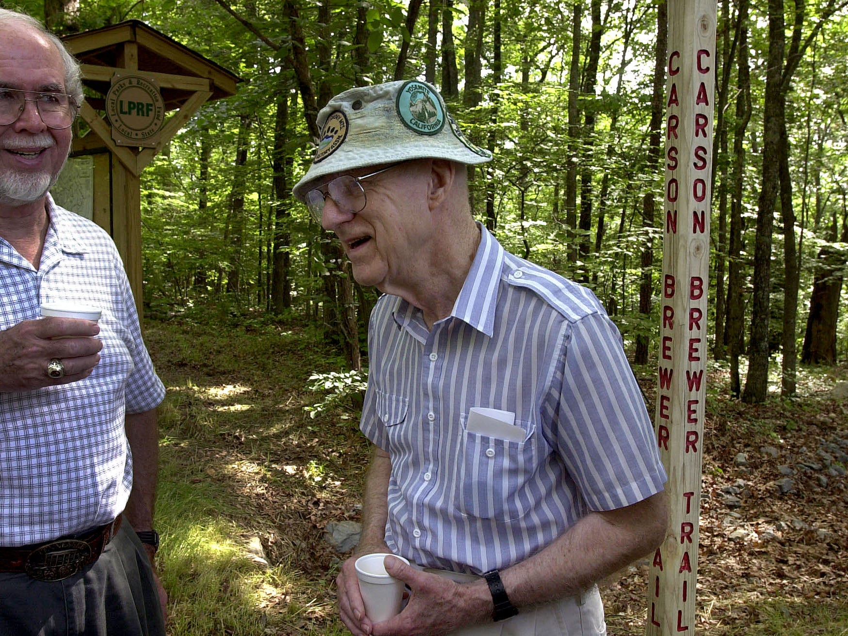 Carson Brewer,right, jokes with Ed McElheney, chairman of the Watershed Board in Norris, after the dedication of a new walking trail. The new trail which has two benches along the route is called the Carson Brewer Trail. The  1000 feet long paved trail was designed with slopes to meet handicapped accessible standards.