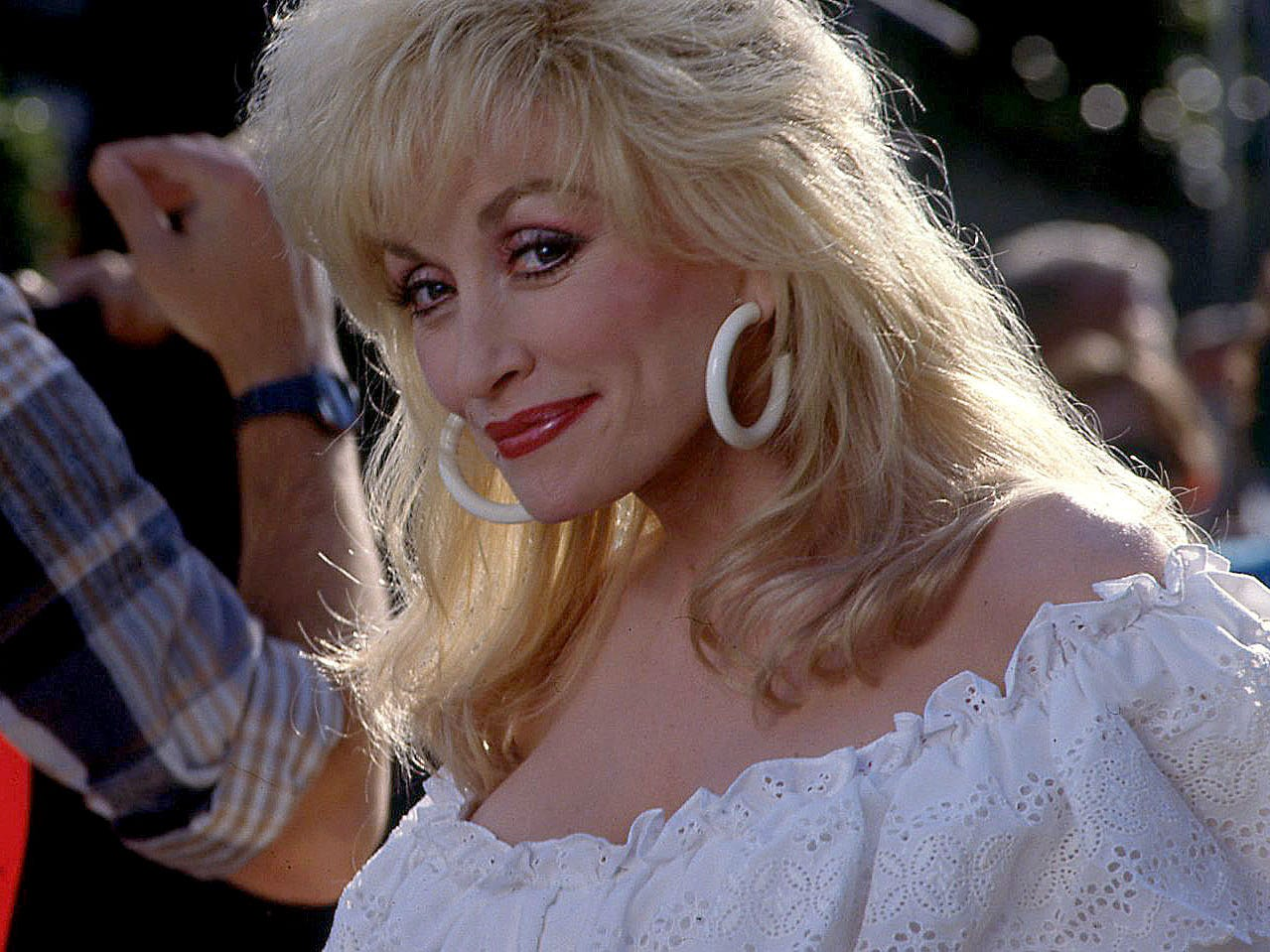 Dolly Parton pauses for a photo while shooting a commercial for the state of Tennessee at Dollywood Nov. 15, 1991.