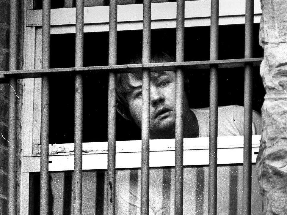 Louis Posey, who faces three kidnapping charges after he took hostages Friday at First National Bank of Oneida, peers from a window in his jail cell on the second floor of the Scott County Jail Sept. 19, 1982 before his hearing. Bond for Posey was set at $300,000 and he will have a preliminary hearing Wednesday.