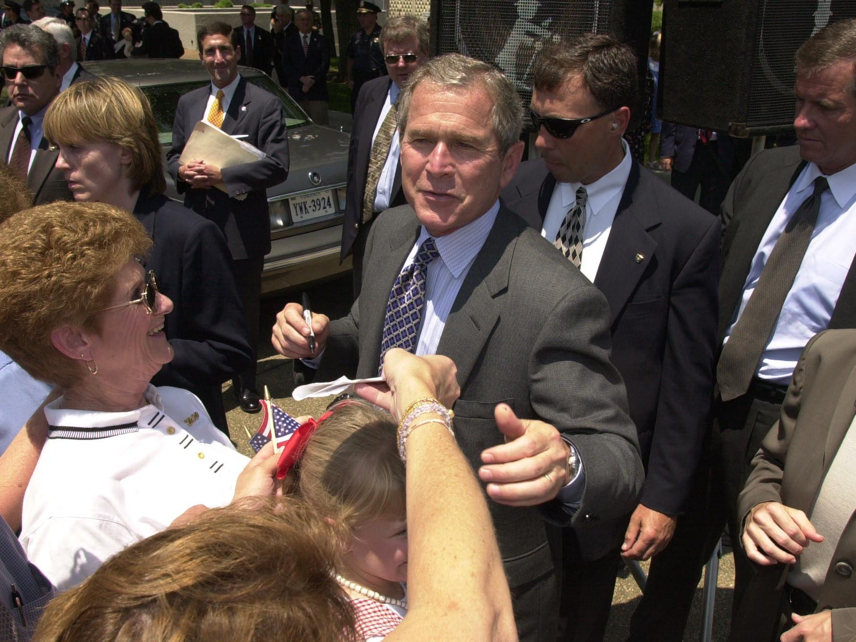 Texas Governor George W. Bush talks to supporters and signs autographs during his 2000 campaign stop Thursday at the Civic Auditorium Plaza in Knoxville.