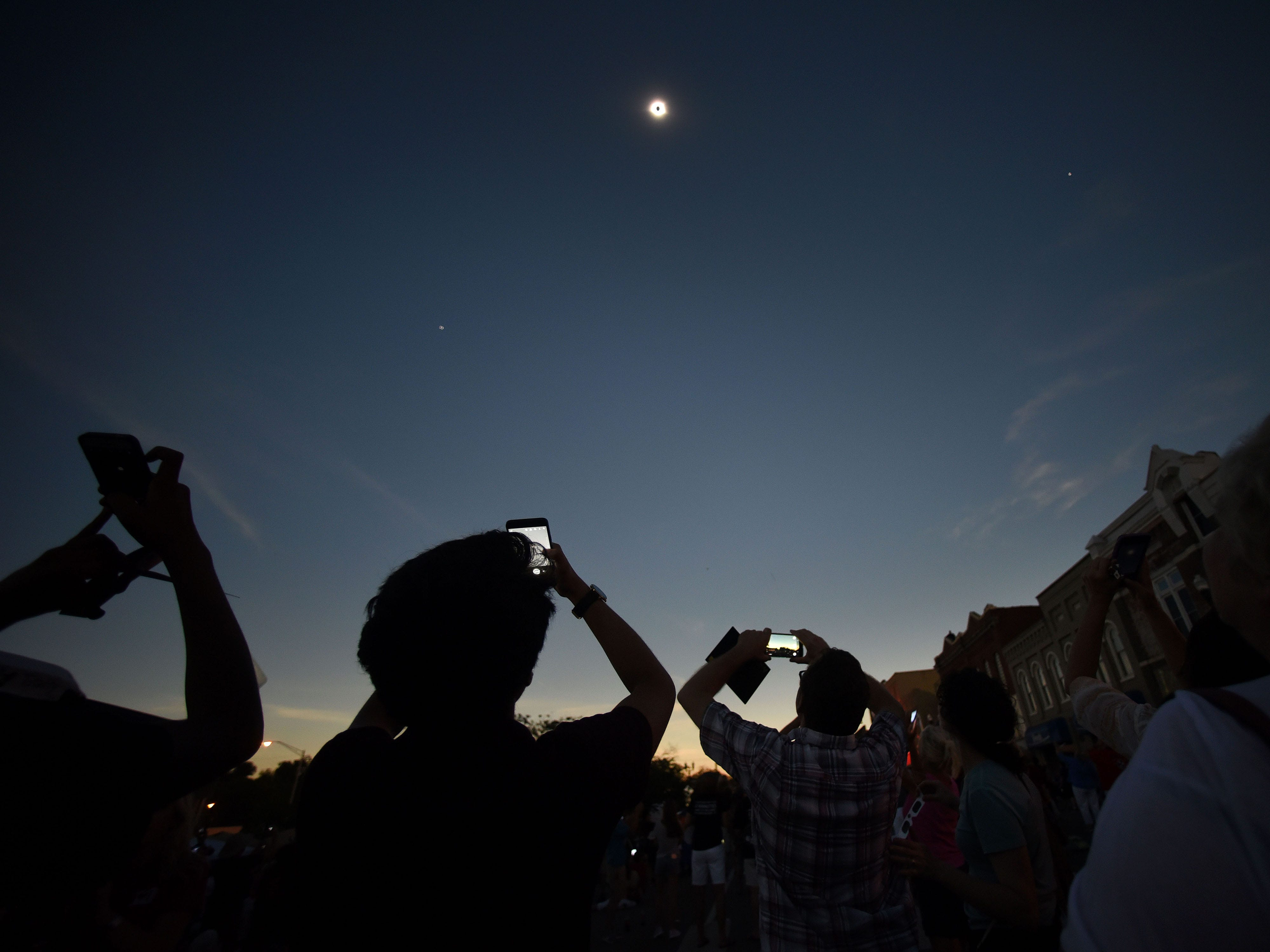 Spectators during totality of the Eclipse 2017 in Downtown Sweetwater Monday, Aug. 21, 2017.