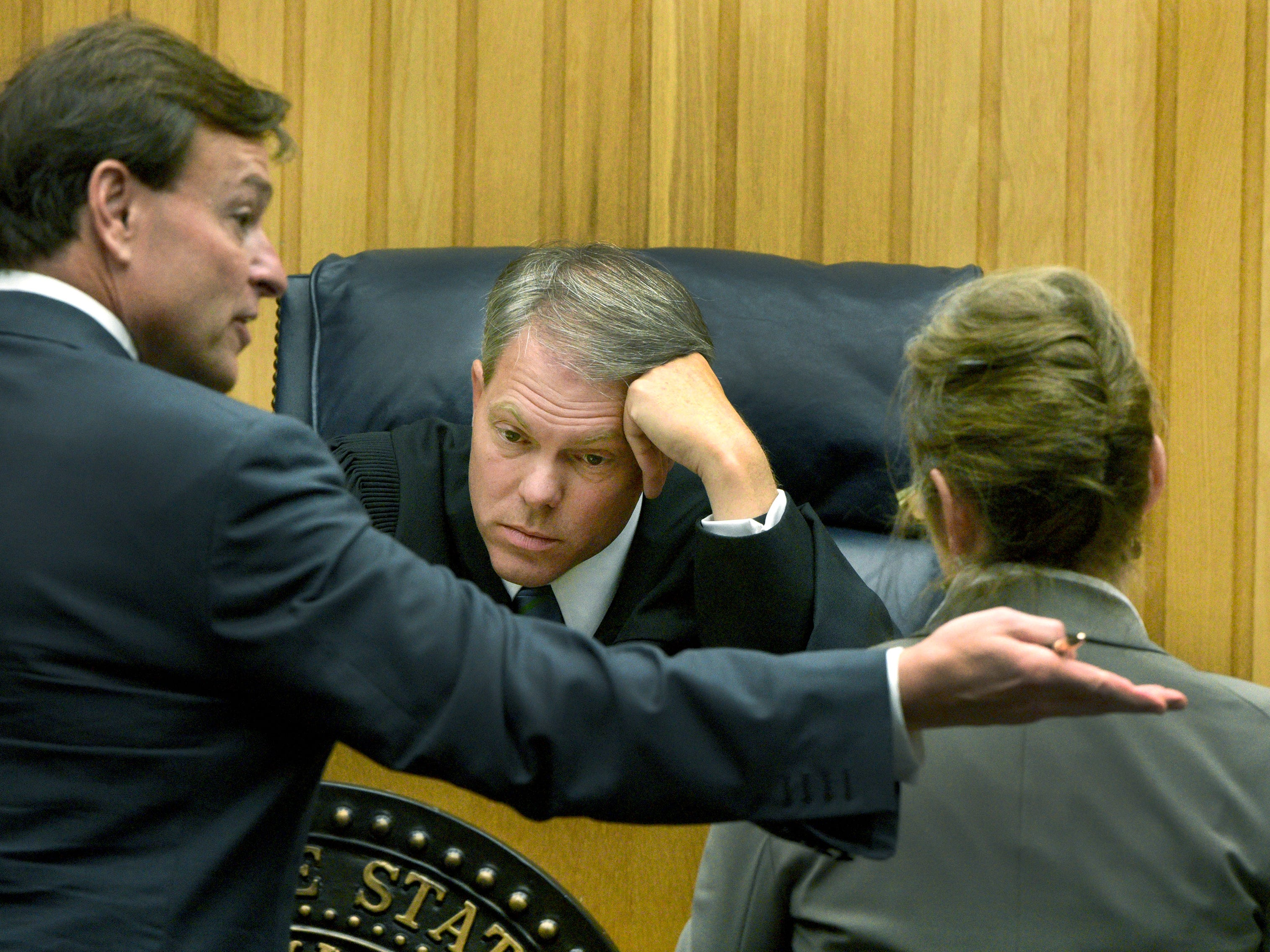 Covering criminal court cases is usually boring and somewhat tedious. Occasionally you can capture a Judge like Steve Sword who seems to tire of the endless arguing over minute legal points from attorneys like Gregory P. Isaacs, left, and ADA Leslie Nassios during a bench conference in the murder trial of Norman Eugene Clark Friday, Aug. 14, 2015.