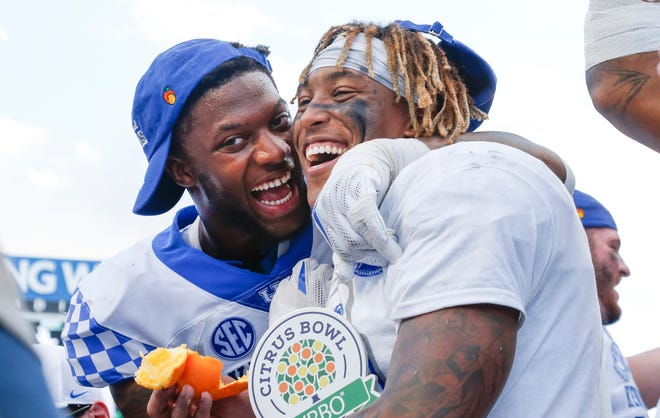 Kentucky Wildcats linebacker Josh Allen (41) and running back Benny Snell Jr. (26) celebrate after defeating the Penn State Nittany Lions in the 2019 Citrus Bowl at Camping World Stadium on Tuesday, Jan. 1, 2019, in Orlando, Florida.