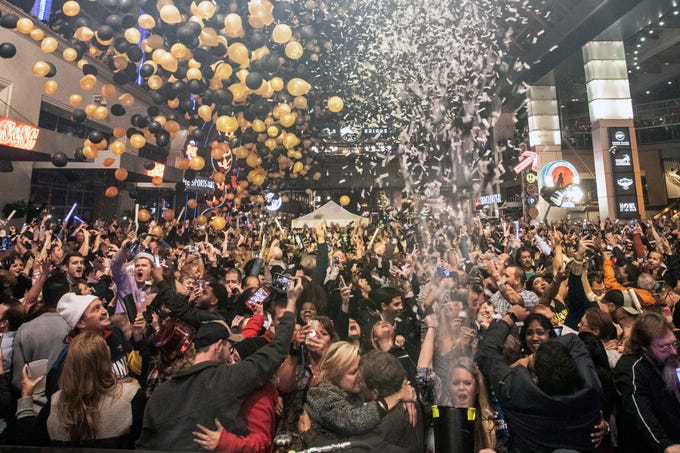 Balloons dropped as confetti cannons erupted over the thousands celebrating the arrival of 2019 at Fourth Street Live on Monday night. January 1, 2019