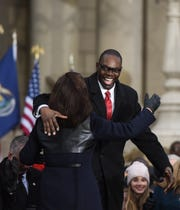 Michigan Governor Gretchen Whitmer hugs Lt. Gov. Garlin Gilchrist Tuesday, Jan. 1, 2019, during the 2019 Inauguration on the steps of the State Capitol in Lansing, Michigan.  [AP Photo/Matthew Dae Smith/Lansing State Journal]