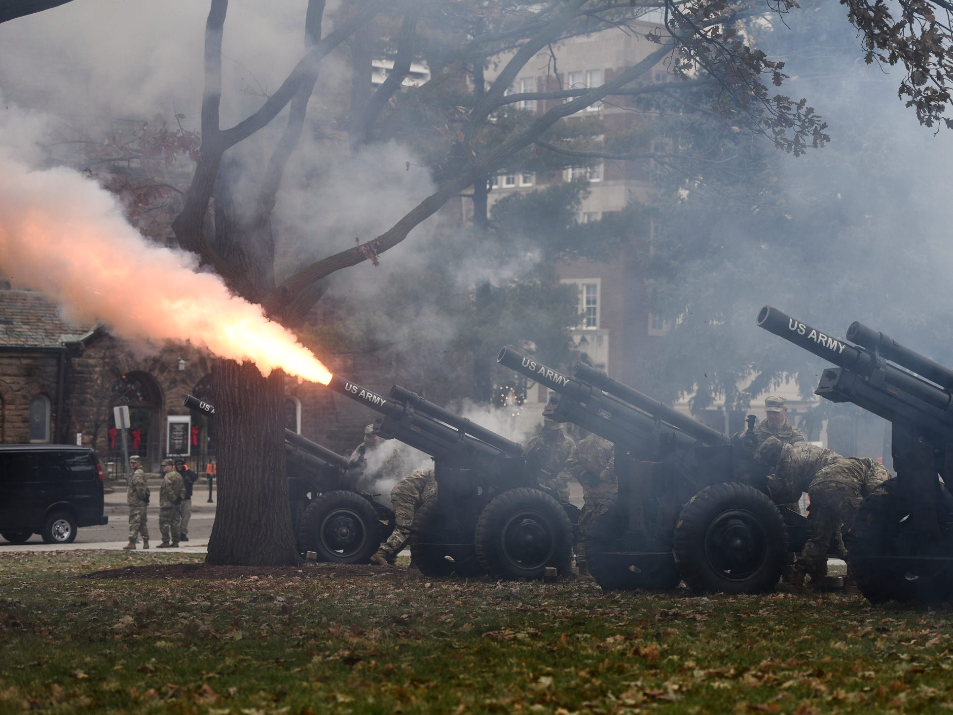 Members of US Army 119th Field Artillery fire a 19-gun salute after the swearing-in of Michigan's 49th Governor Gretchen Whitmer.  [AP Photo/Matthew Dae Smith/Lansing State Journal]