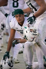 Michigan State wide receiver Cody White (7) is consoled by teammate after the team's 7-6 loss to Oregon during the Redbox Bowl NCAA college football game Monday, Dec. 31, 2018, in Santa Clara, Calif.