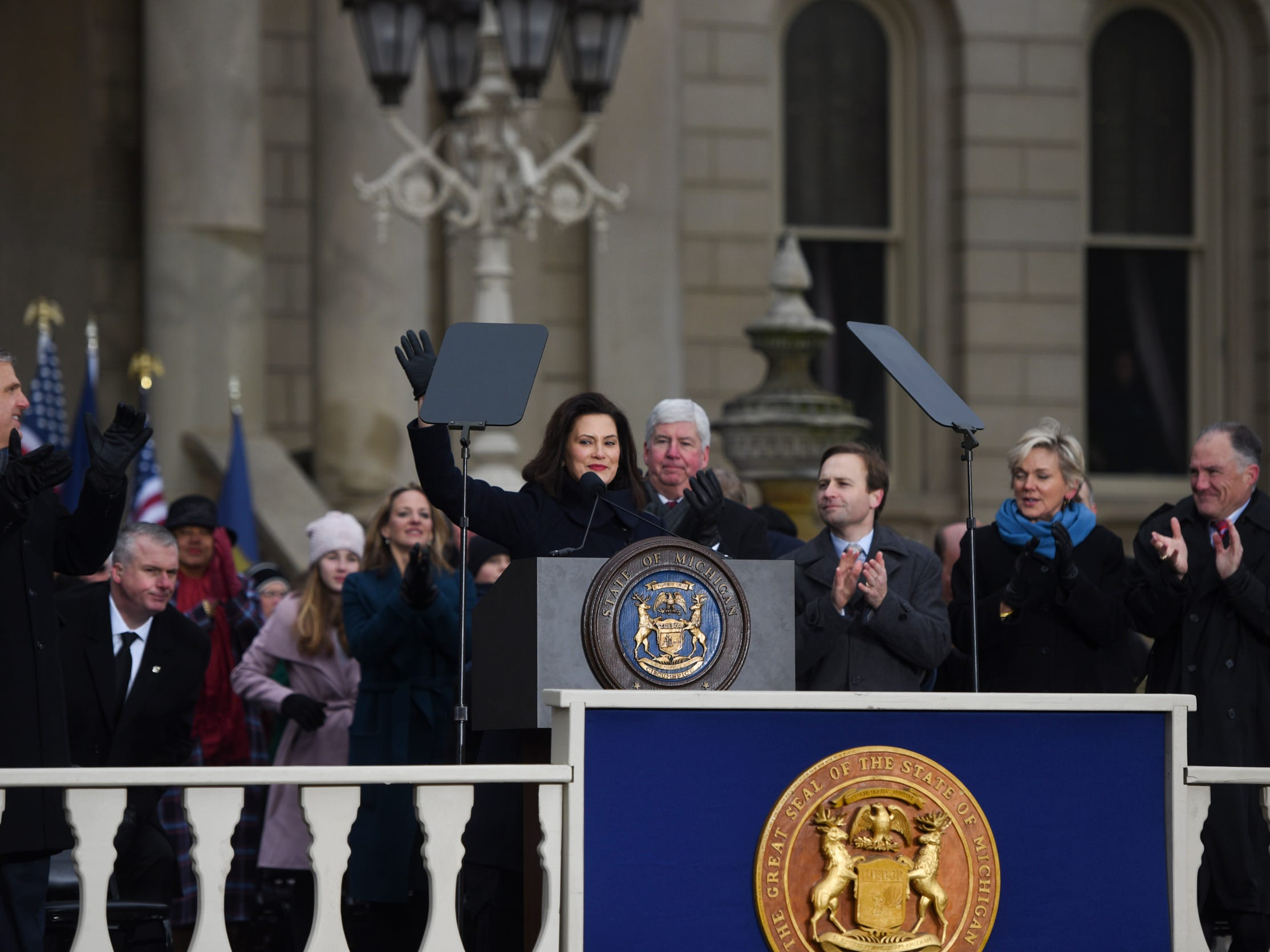 Michigan Governor Gretchen Whitmer hugs Lt. Gov. thanks her supporters Tuesday, Jan. 1, 2019, after being sworn-in as Michigan's 49th governor on the steps of the State Capitol in Lansing, Michigan.  [AP Photo/Matthew Dae Smith/Lansing State Journal]