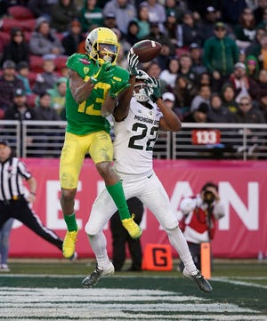 Michigan State cornerback Josiah Scott (22) breaks up a pass for Oregon wide receiver Dillon Mitchell (13) during the second half of the Redbox Bowl NCAA college football game Monday, Dec. 31, 2018, in Santa Clara, Calif. Oregon won 7-6.