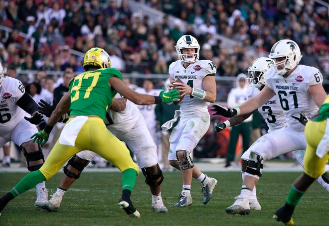 Michigan State quarterback Brian Lewerke (14) drops back to pass against Oregon during the second half of the Redbox Bowl NCAA college football game Monday, Dec. 31, 2018, in Santa Clara, Calif.