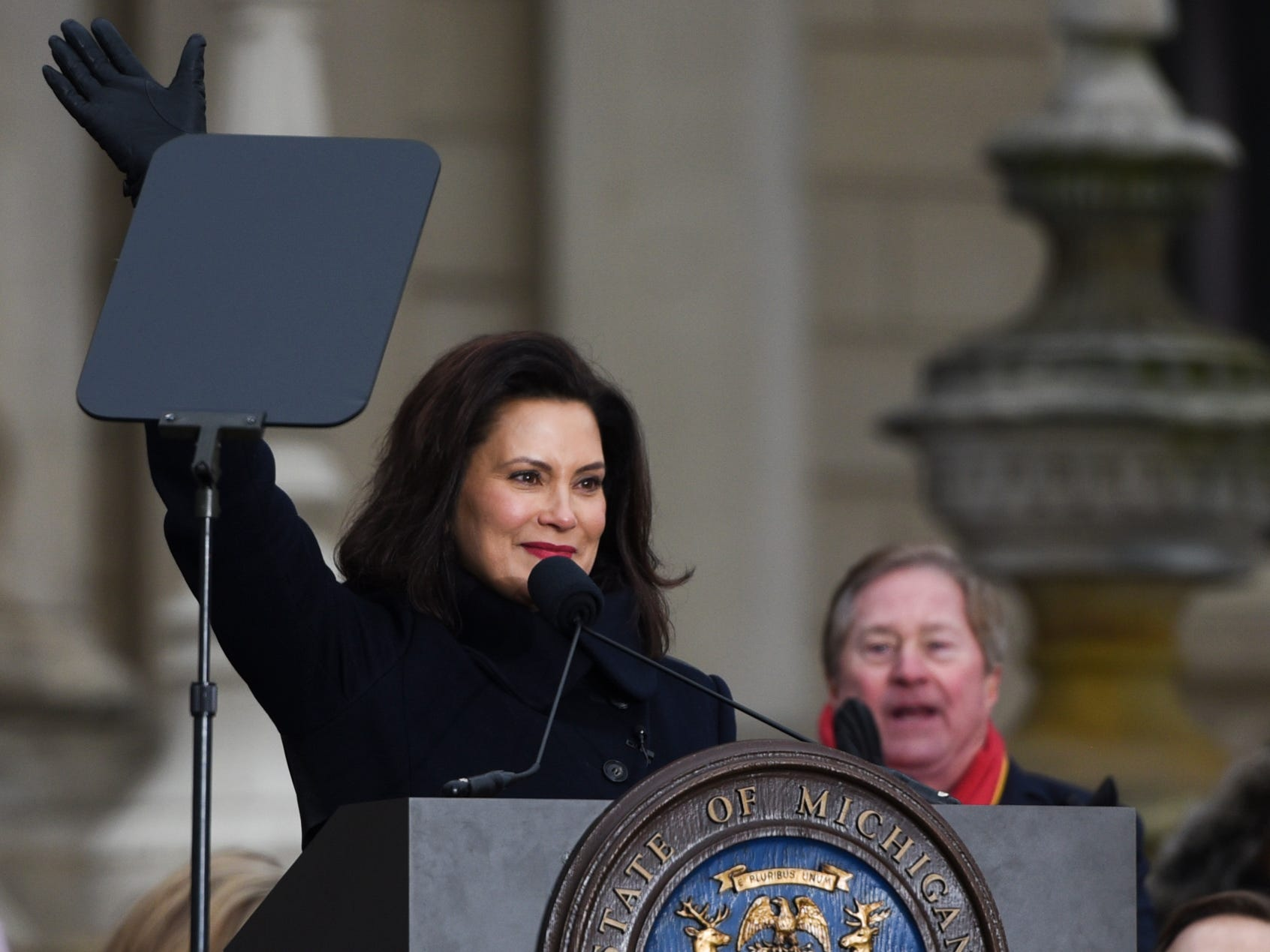 Michigan Governor Gretchen Whitmer waves Tuesday, Jan. 1, 2019, after being sworn-in as Michigan's 49th governor on the steps of the State Capitol in Lansing, Michigan.  [AP Photo/Matthew Dae Smith/Lansing State Journal]