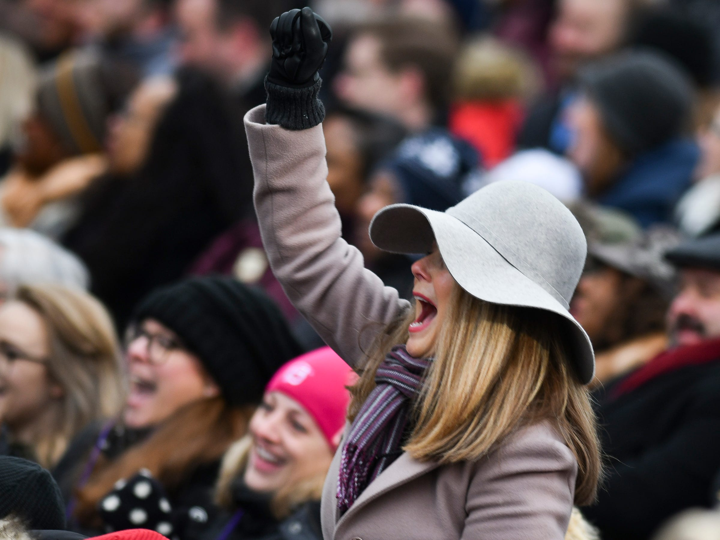 A woman cheers as Michigan Governor Gretchen Whitmer thanks her supporters for their help, Tuesday, Jan. 1, 2019, at the State Capitol during the inaugural ceremony.