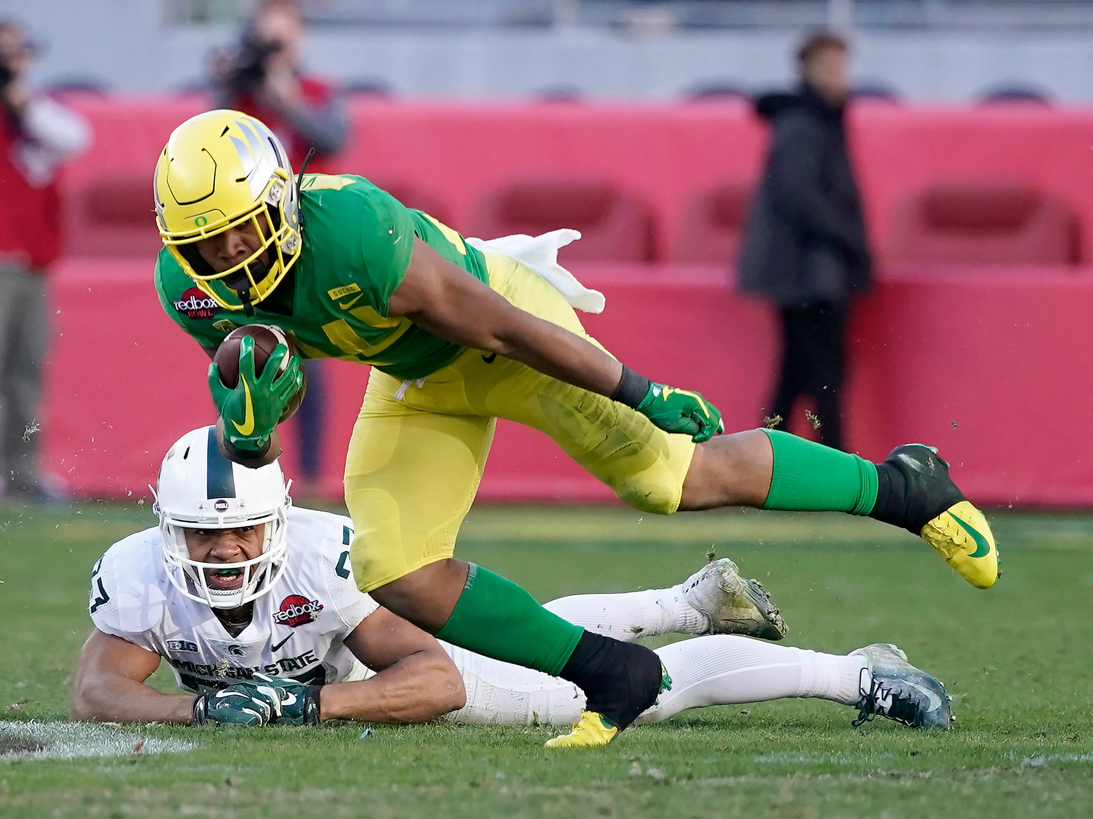 Oregon running back CJ Verdell (34) breaks a tackle by Michigan State safety Khari Willis (27) during the second half of the Redbox Bowl NCAA college football game Monday, Dec. 31, 2018, in Santa Clara, Calif. Oregon won 7-6.
