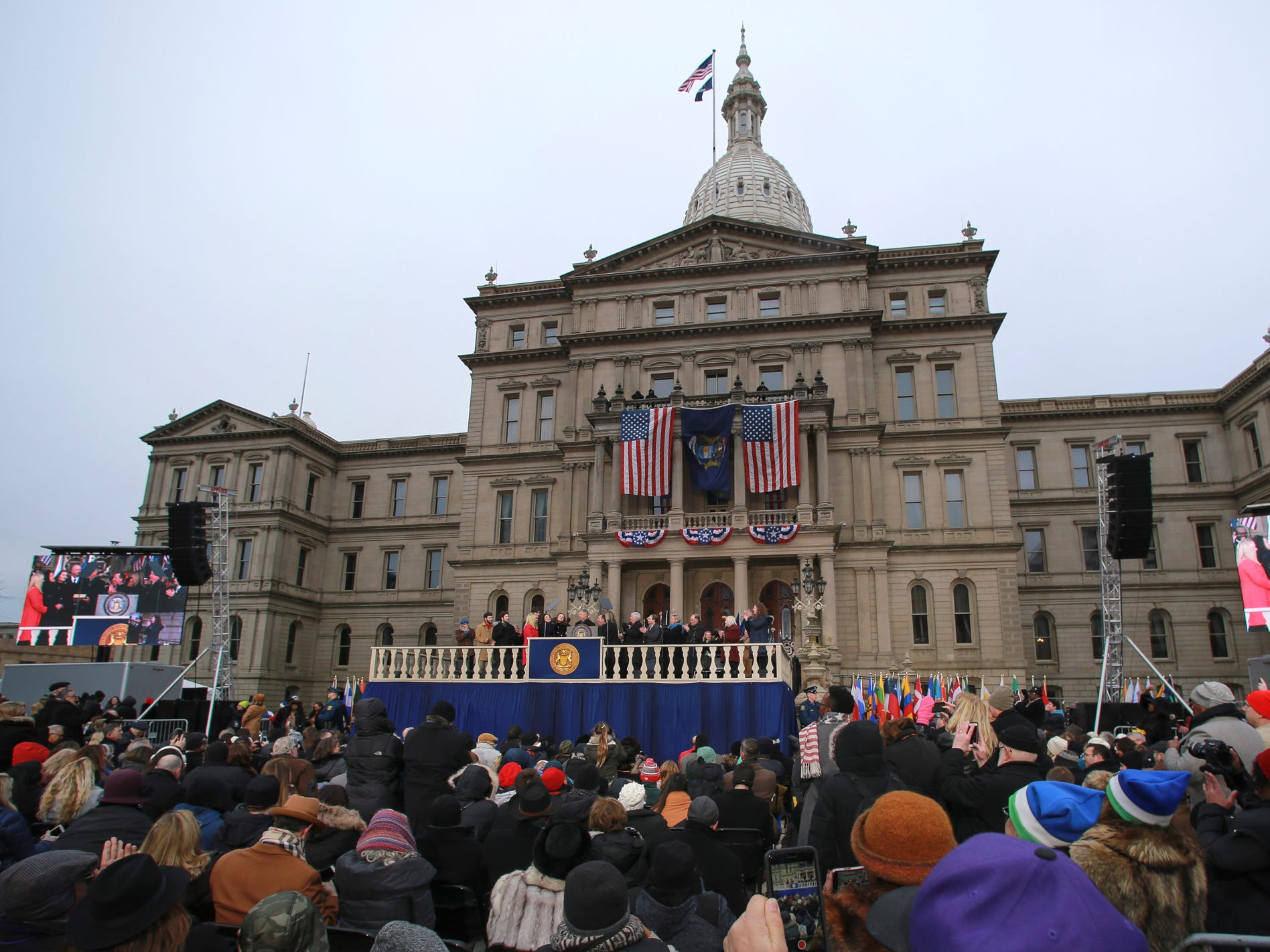 Michigan Governor Gretchen Whitmer was sworn-in as Michigan's 49th governor on the steps of the State Capitol in Lansing,  Tuesday, Jan. 1, 2019.  [AP Photo/Matthew Dae Smith/Lansing State Journal]