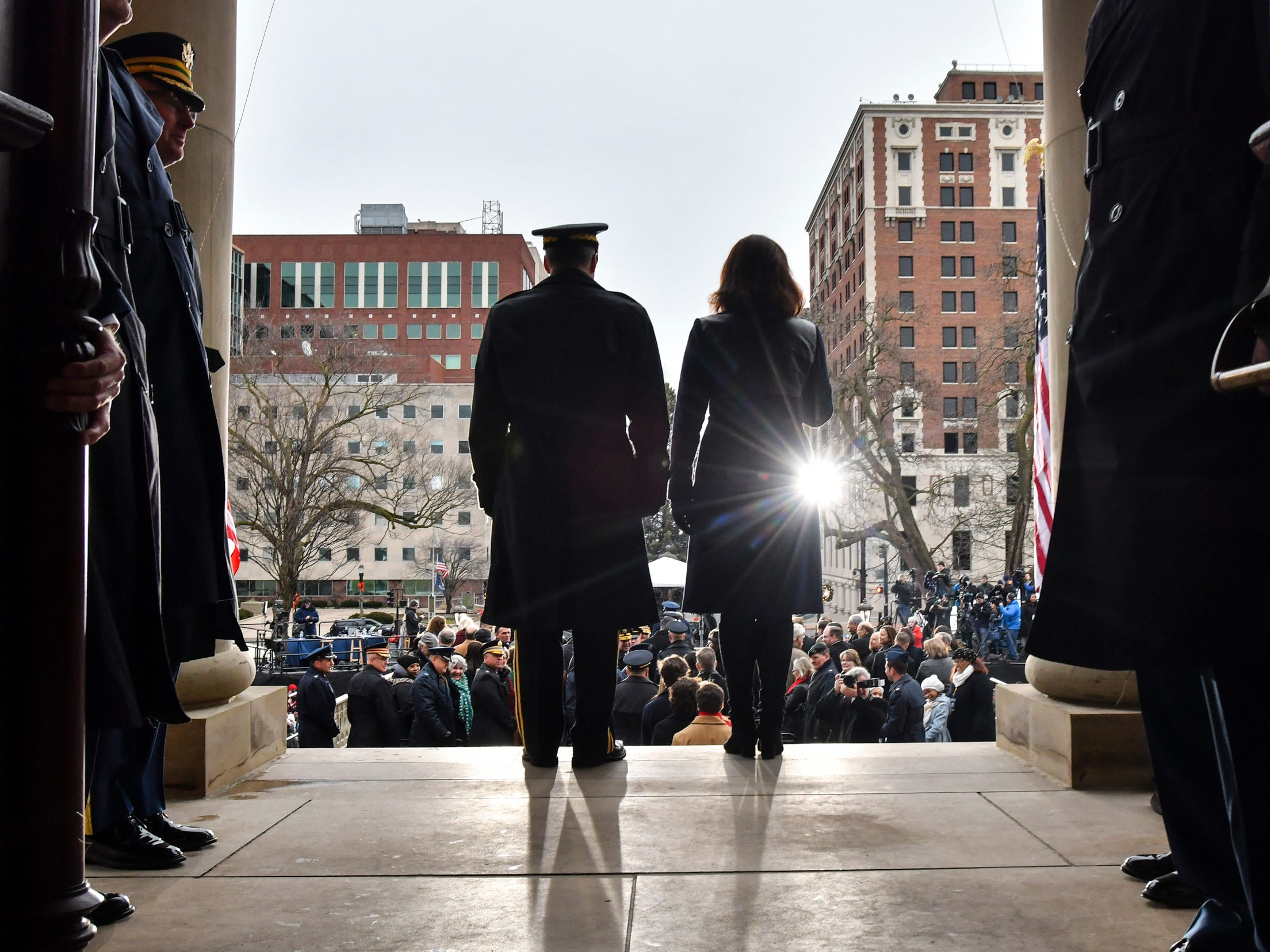 Michigan Governor Gretchen Whitmer gets a military escort onto the Capitol stairs, Tuesday, Jan. 1, 2019, prior to being sworn-in as Michigan's 49th governor.  [AP Photo/Matthew Dae Smith/Lansing State Journal]