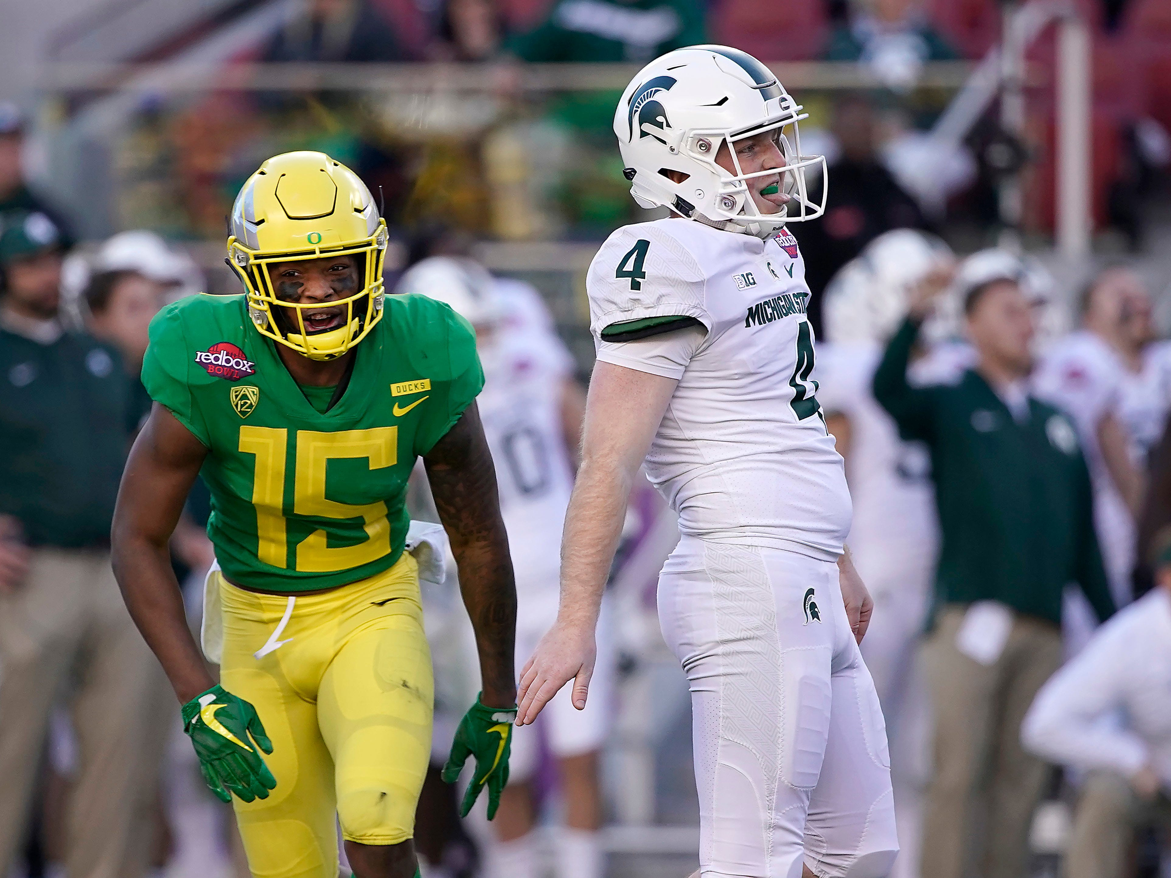 Oregon's Deommodore Lenoir (15) reacts after Michigan State place-kicker Matt Coghlin (4) missed a field goal during the second half of the Redbox Bowl NCAA college football game Monday, Dec. 31, 2018, in Santa Clara, Calif. Oregon won 7-6.