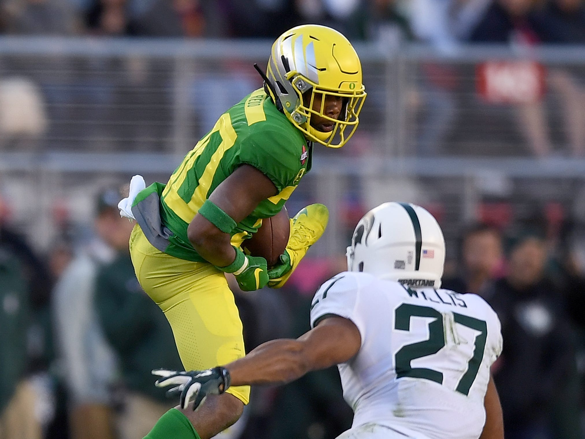 Jaylon Redd #30 of the Oregon Ducks catches a pass over Khari Willis #27 of the Michigan State Spartans during the second half of the Redbox Bowl at Levi's Stadium on December 31, 2018 in Santa Clara, California.