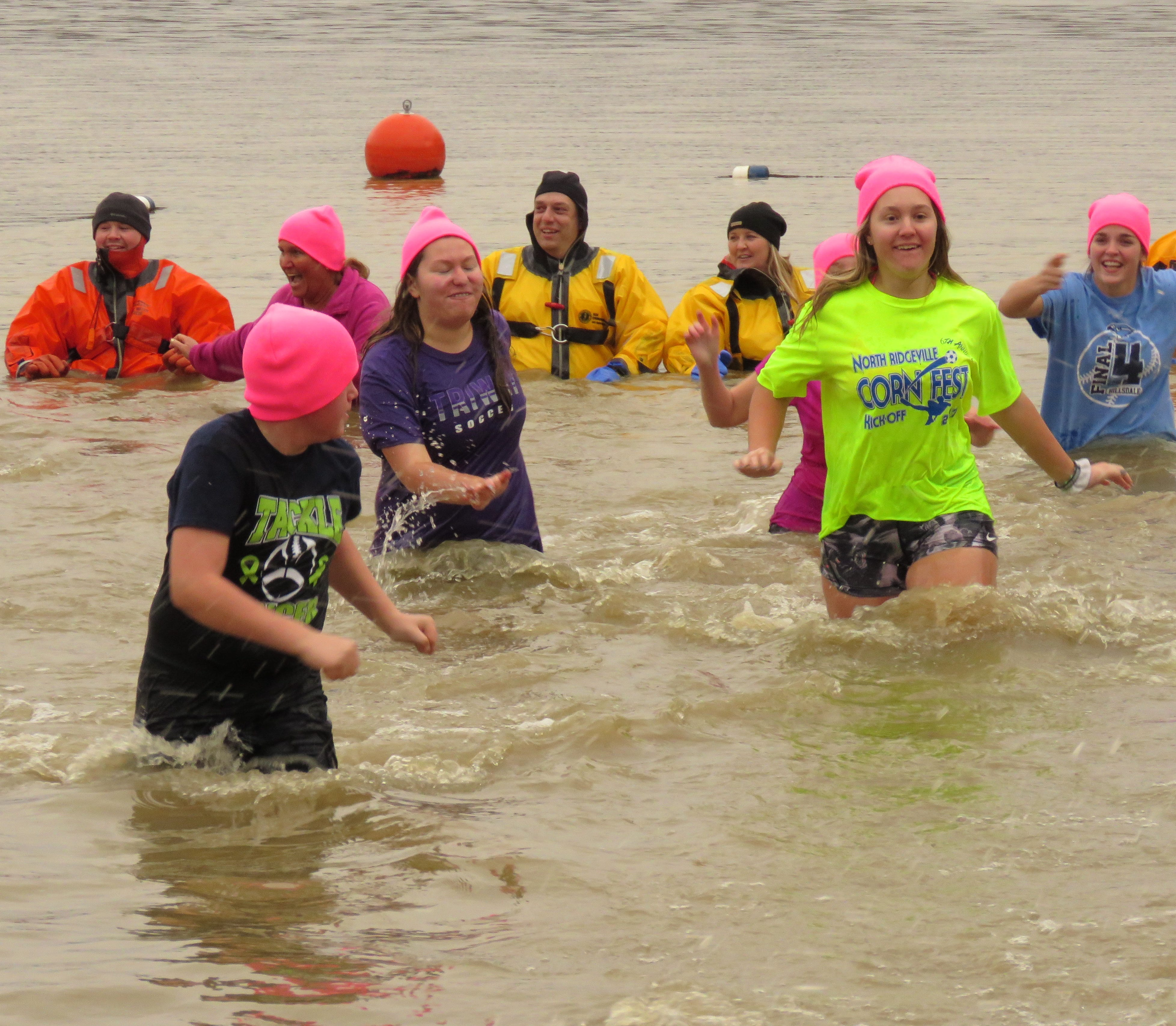 The annual Polar Dip on New Year's Day attracted quite a crowd at Charles Mill Lake Park.