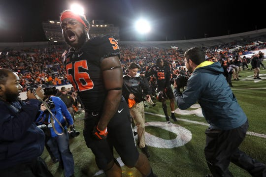 Oklahoma State Cowboys lineman Larry Williams celebrates after they defeated the Missouri Tigers at the Autozone Liberty Bowl on Monday, Dec. 31, 2018.