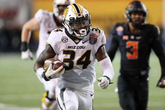 Missouri Tigers' Larry Rountree III runs the ball against the Oklahoma State Cowboys at the Autozone Liberty Bowl on Monday, Dec. 31, 2018.