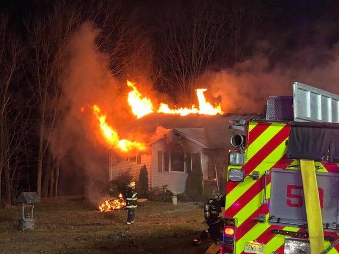 A fire burns through a Mount Olive house Jan. 1, 2019.