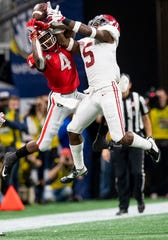 Alabama defensive back Shyheim Carter (5) breaks up a pass intended for Georgia wide receiver Mecole Hardman (4) in the SEC Championship Game at Mercedes Benz Stadium in Atlanta, Ga., on Saturday December 1, 2018.