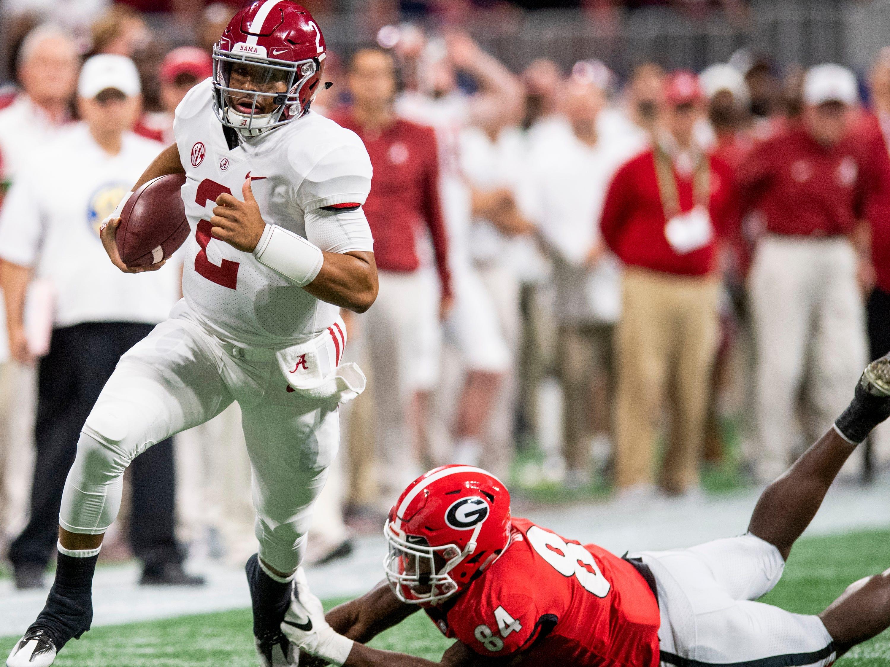 Alabama quarterback Jalen Hurts (2) carries the ball against Georgia in the SEC Championship Game at Mercedes Benz Stadium in Atlanta, Ga., on Saturday December 1, 2018.