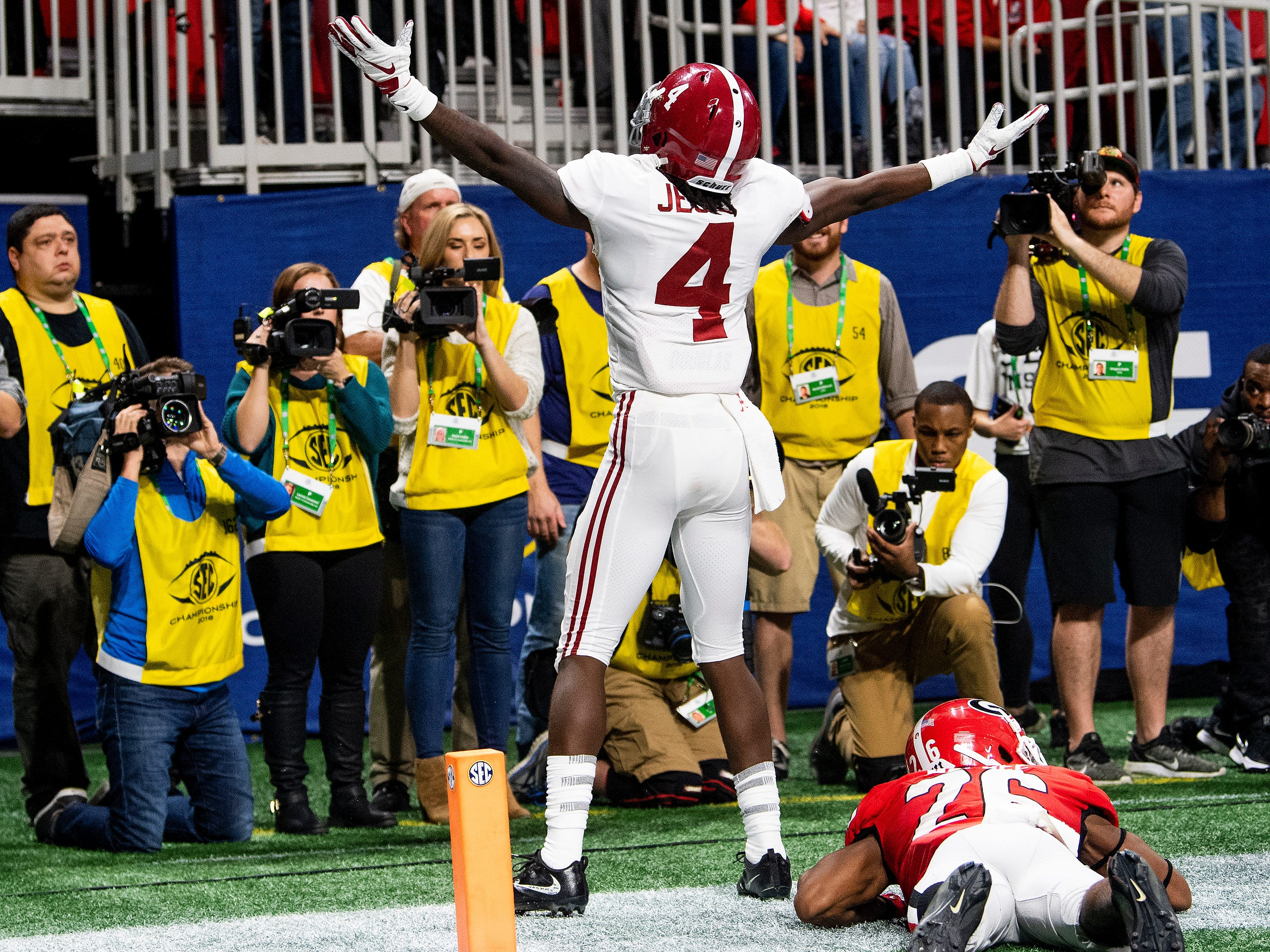 Alabama wide receiver Jerry Jeudy (4) scelebrates after his fourth quarter touchdown catch against Georgia in the SEC Championship Game at Mercedes Benz Stadium in Atlanta, Ga., on Saturday December 1, 2018.