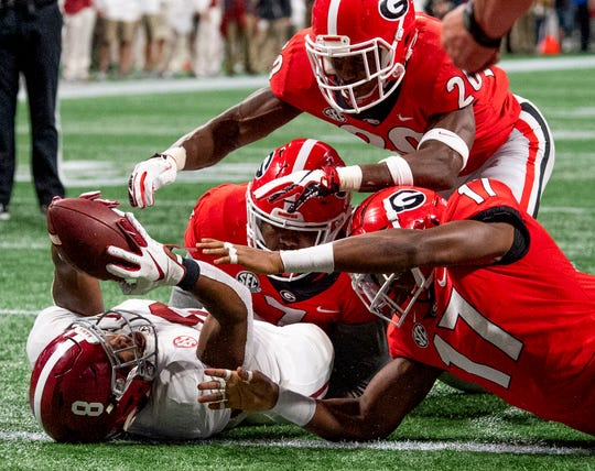 Alabama running back Josh Jacobs (8) receives an Alabama fumble in the endzone for a touchdown against Georgia during first half action of the SEC Championship Game at Mercedes Benz Stadium in Atlanta, Ga., on Saturday December 1, 2018.